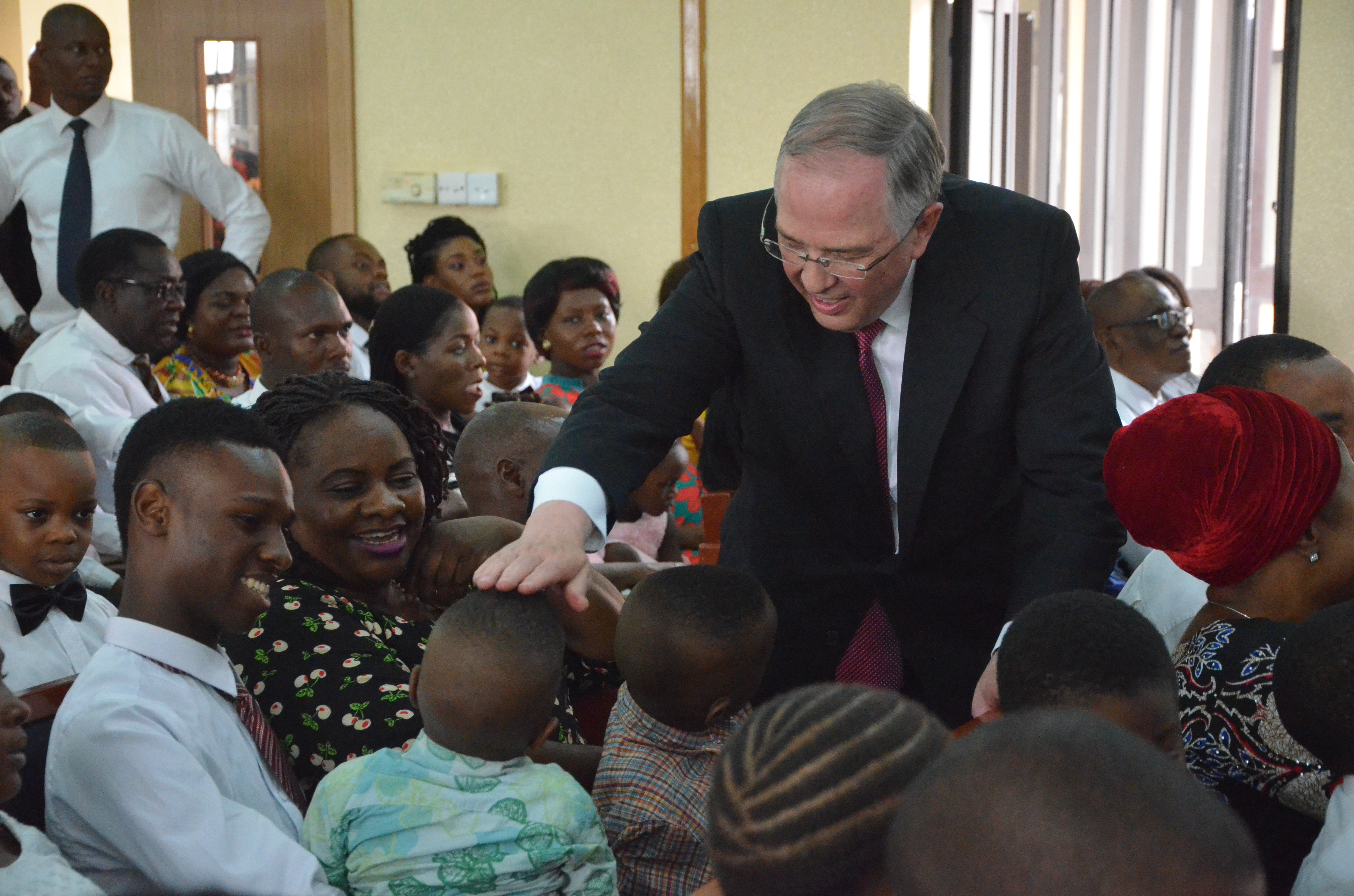 Elder Neil L. Andersen of the Quorum of the Twelve Apostles visits with members during his visit to the Africa West Area of the Church.