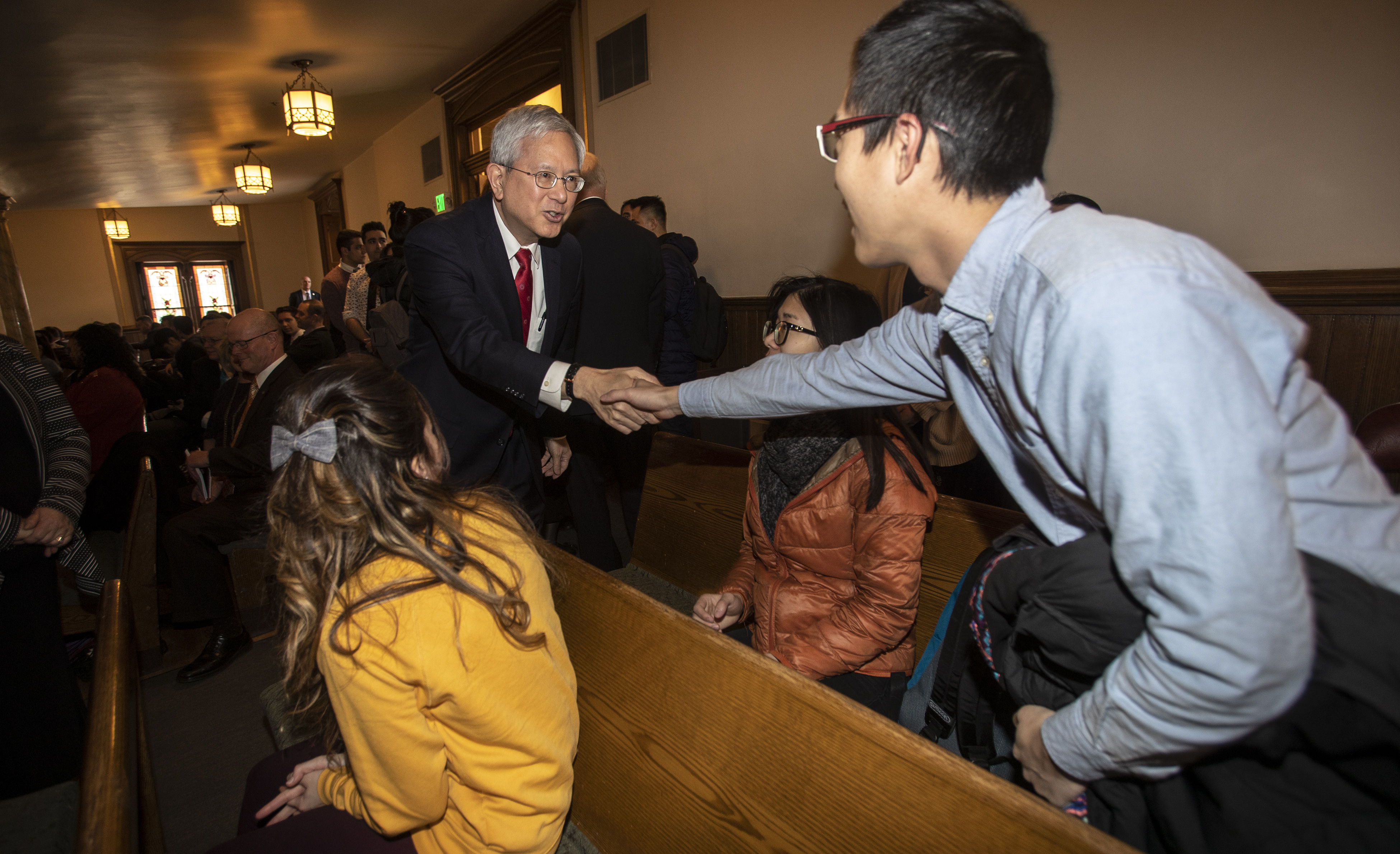 Elder Gerrit W. Gong of the Quorum of the Twelve Apostles of The Church of Jesus Christ of Latter-day Saints greets students and staff from LDS Business College in the Assembly Hall on Temple Square in Salt Lake City on Tuesday, Feb. 26, 2019.