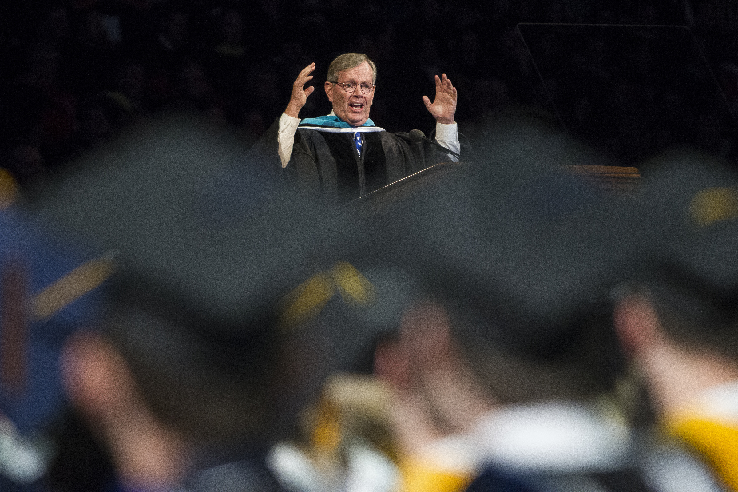 Former Utah Governor Mike Leavitt speaks to graduates after receiving an honorary degree during Brigham Young University's commencement ceremony in the Marriott Center on Thursday, April 26, 2018, in Provo. BYU is awarding nearly 6,300 degrees to graduates this week.