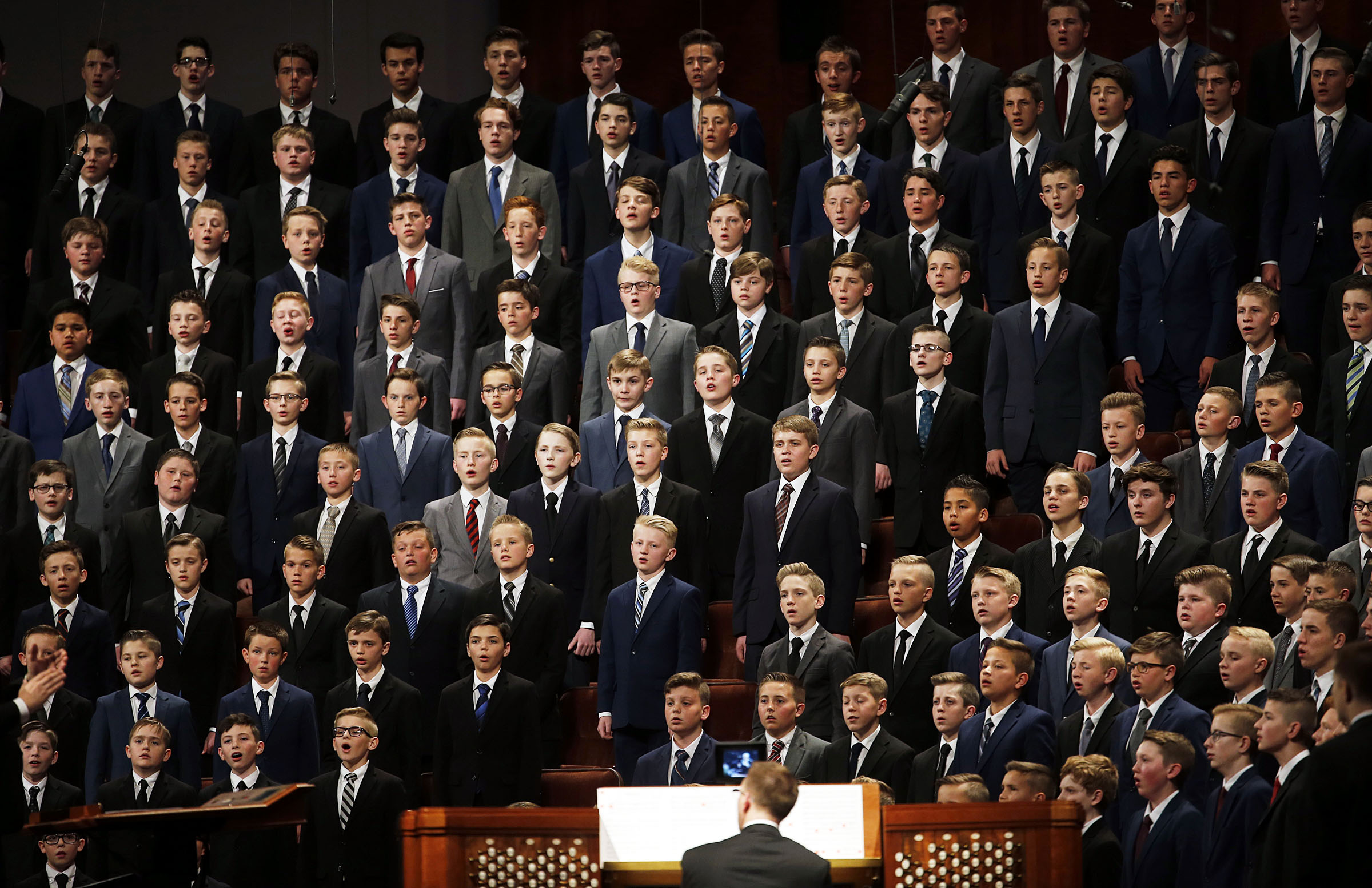 An Aaronic Priesthood choir from stakes in Layton, Utah, sings during the 189th Annual General Conference of The Church of Jesus Christ of Latter-day Saints in the Conference Center in Salt Lake City on Saturday, April 6, 2019.