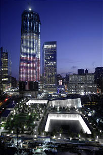 One World Trade Center and the National September 11 Memorial are seen, Monday, Sept. 12, 2011, in New York. The memorial is scheduled to the public Monday, with much of the complex expected to open next year.