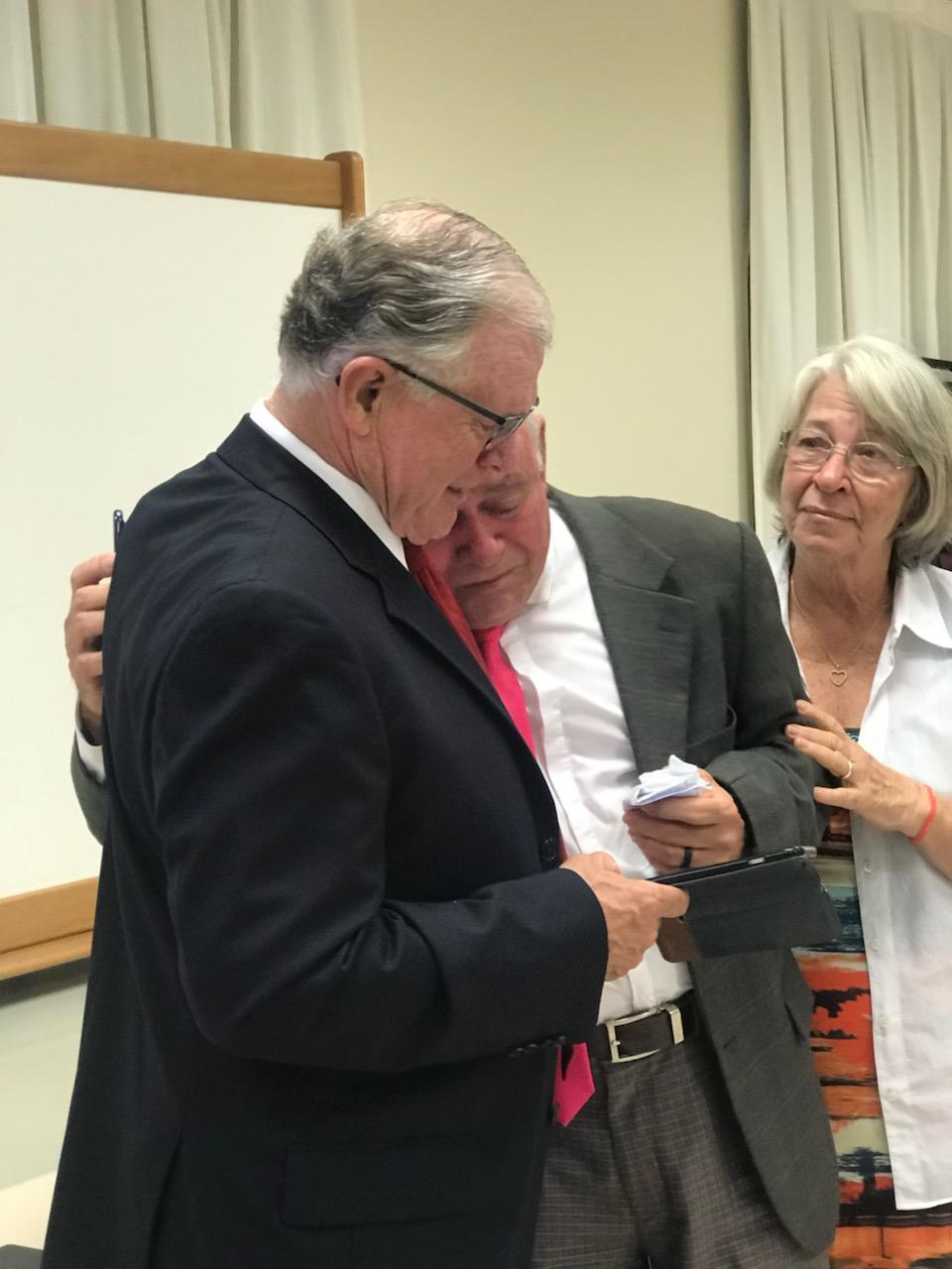 Sharing a tearful reunion are John Beck, left, and Antonio Ferreira, center, on June 1, 2019, in Fortaleza, Brazil. As a missionary in 1966, Beck helped teach and convert the Ferreira family, who were the city's first Church members.