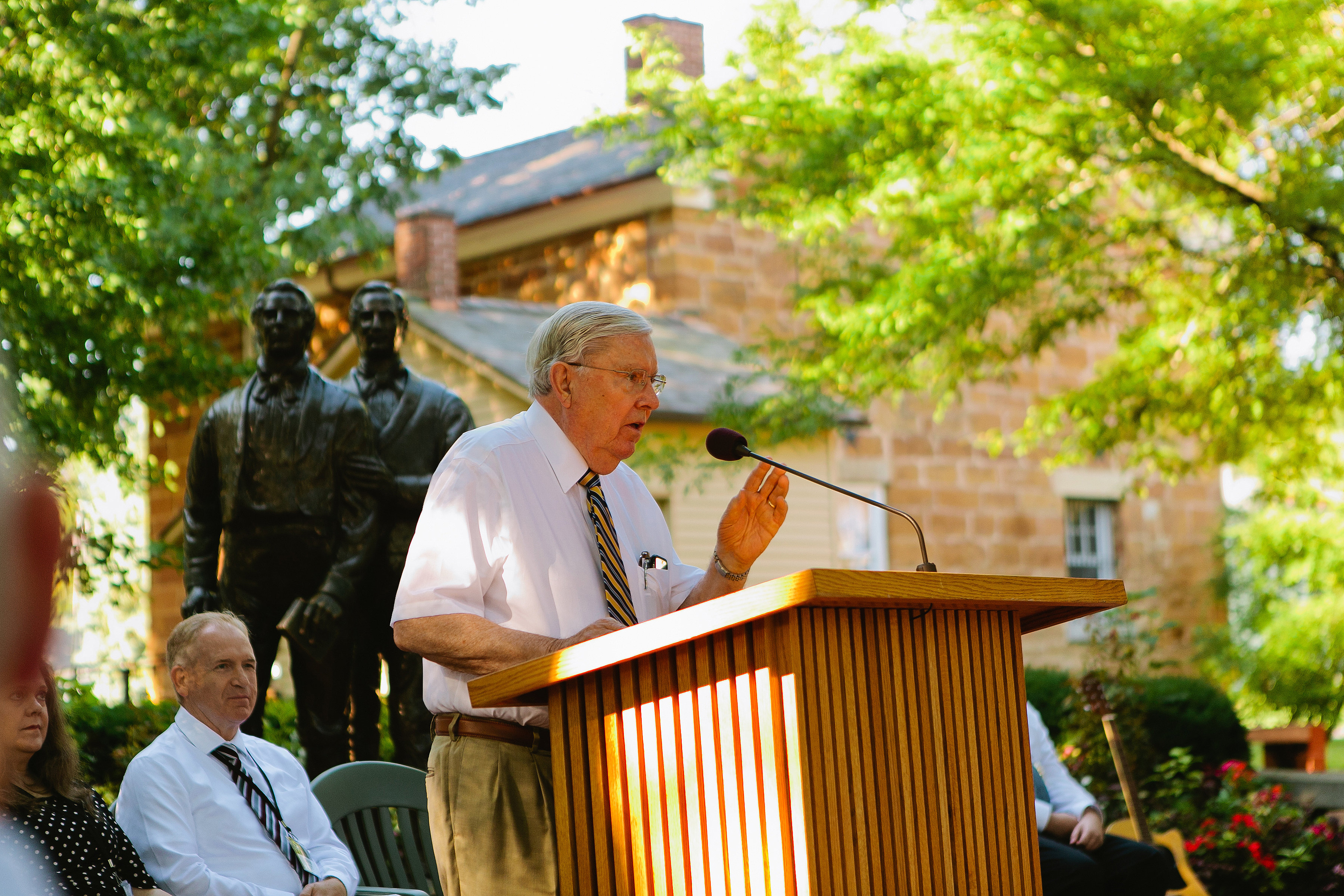 Elder M. Russell Ballard speaks at a devotional held outside Carthage Jail on Aug. 5. The devotional commemorated the 25th anniversary of the dedication of the Smith Family Cemetery.