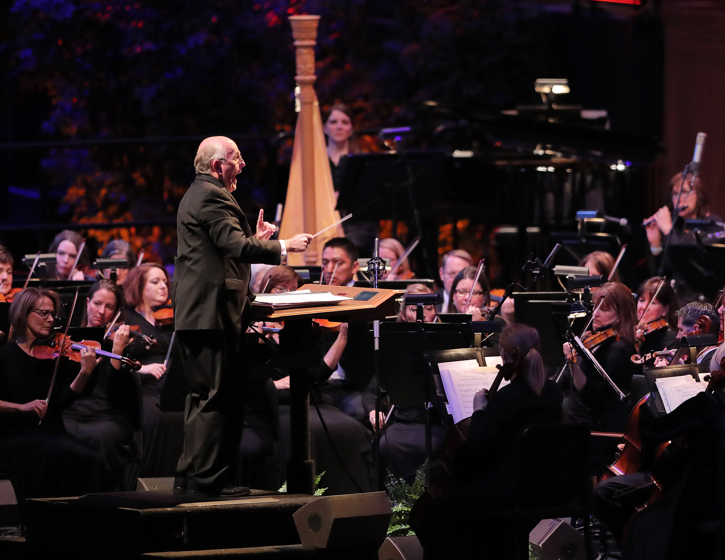 """Mack Wilberg conducts the Mormon Tabernacle Choir and Orchestra at Temple Square in their annual Pioneer Concert, with guest performers Matthew Morrison, Laura Michelle Kelly and narrator Oscar """"Andy"""" Hammerstein III, at the Conference Center in Salt Lake on Friday, July 20, 2018."""