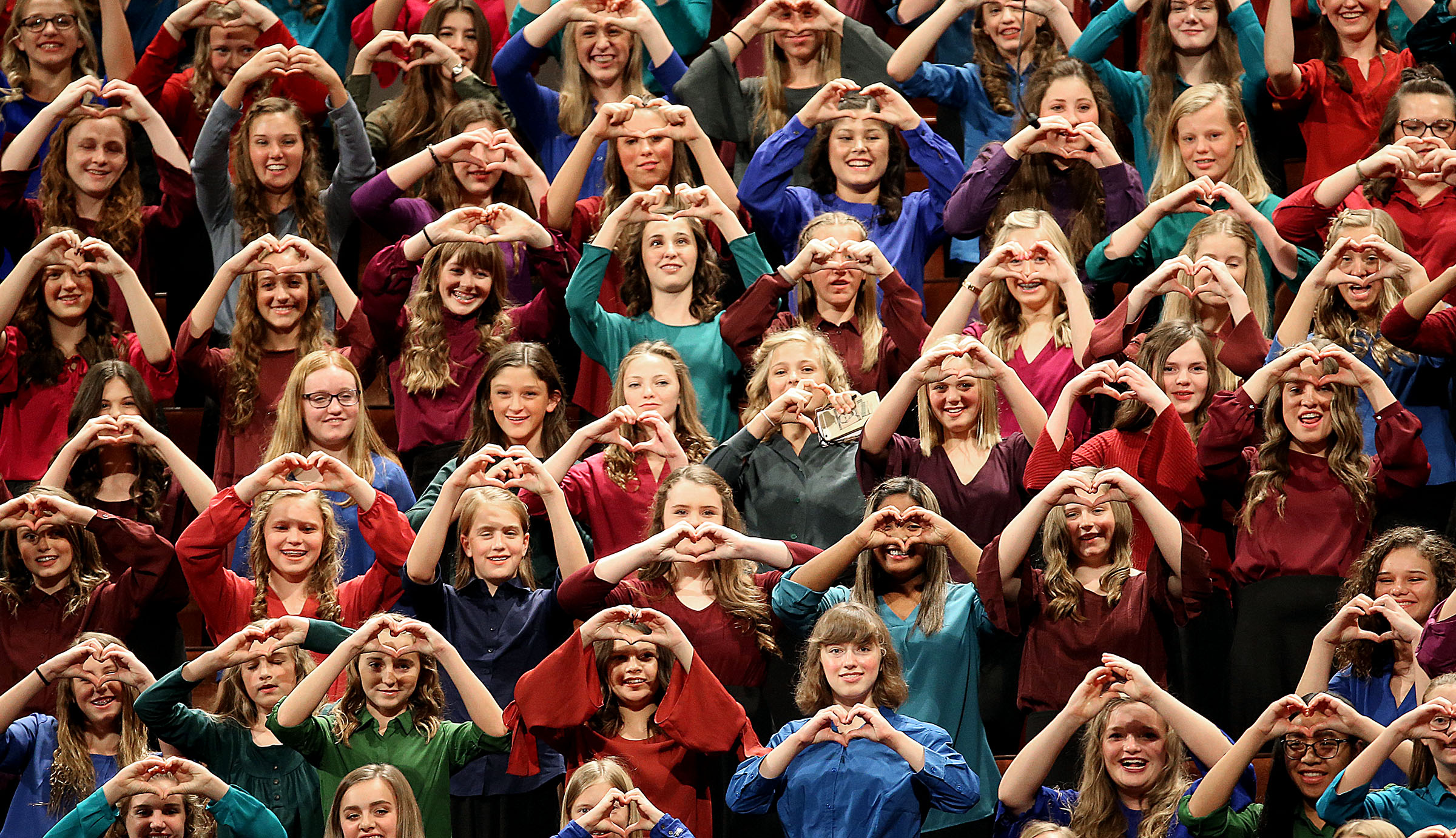 Members of the Young Women choir from stakes in Pleasant Grove form hearts with their hands as President Russell M. Nelson leaves the general women's session of the 188th Semiannual General Conference of The Church of Jesus Christ of Latter-day Saints held in the Conference Center in downtown Salt Lake City on Saturday, Oct. 6, 2018.