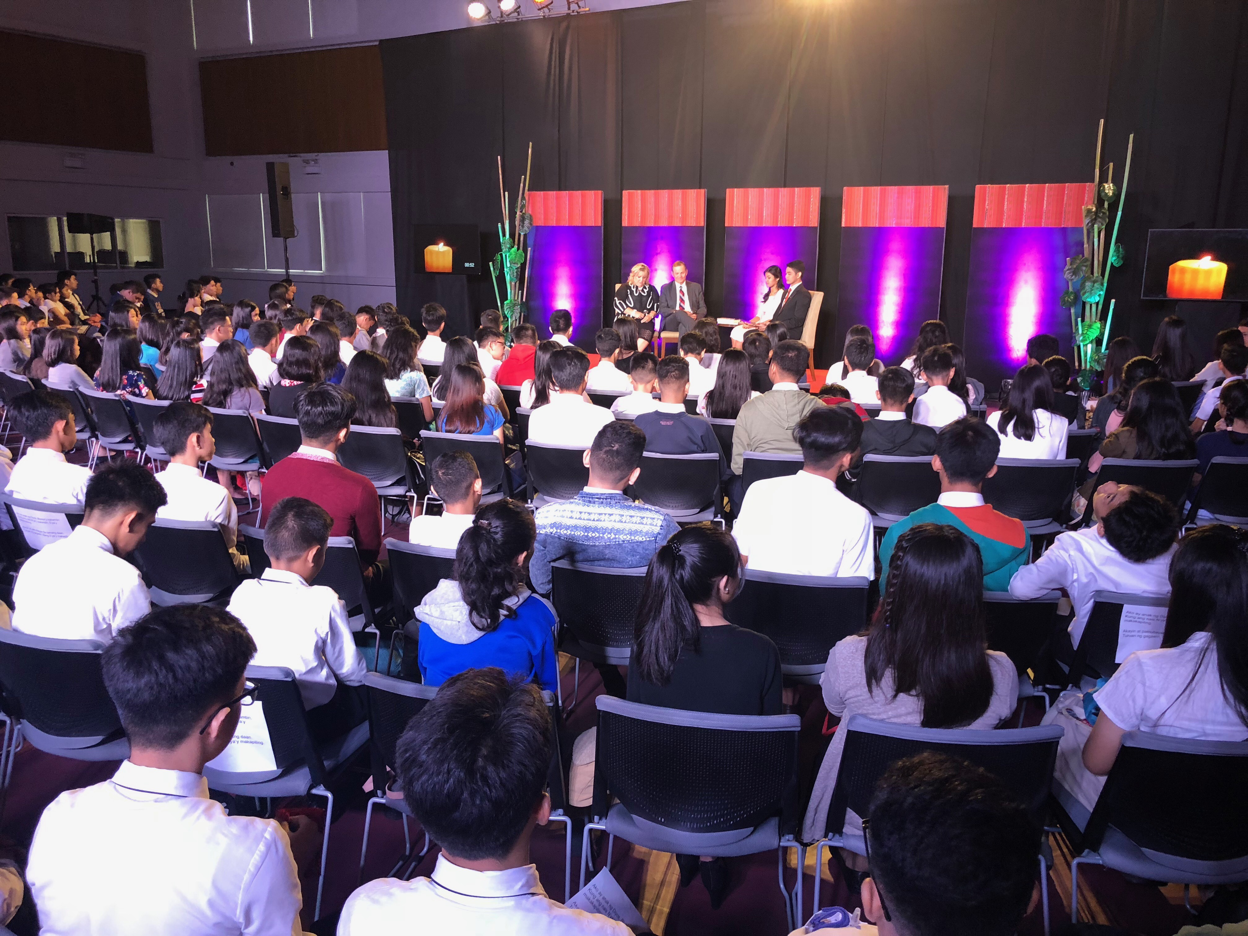 Elder Gary E. Stevenson and his wife, Sister Lesa Stevenson, participate in a regional Face to Face event with youth in Asia on Aug. 11, 2018.
