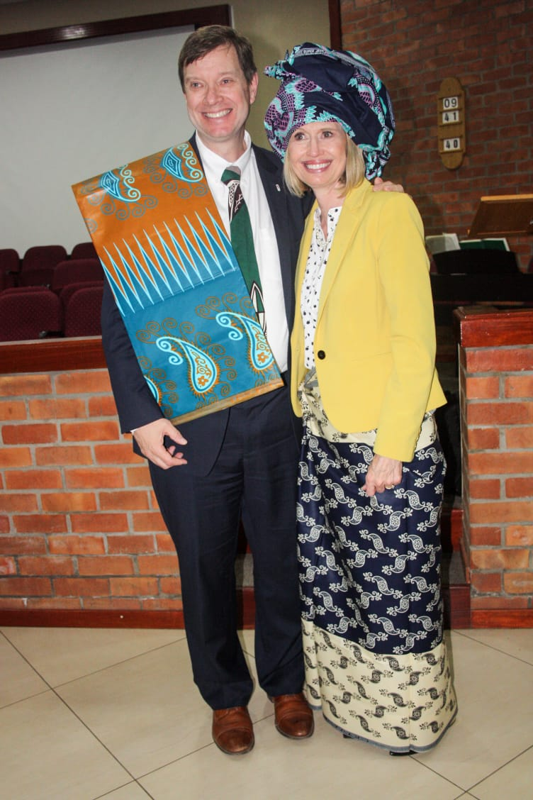 Sister Bonnie H. Cordon, Young Women general president, and her husband, Derek Cordon, dress with traditional Capulanas in Mozambique.