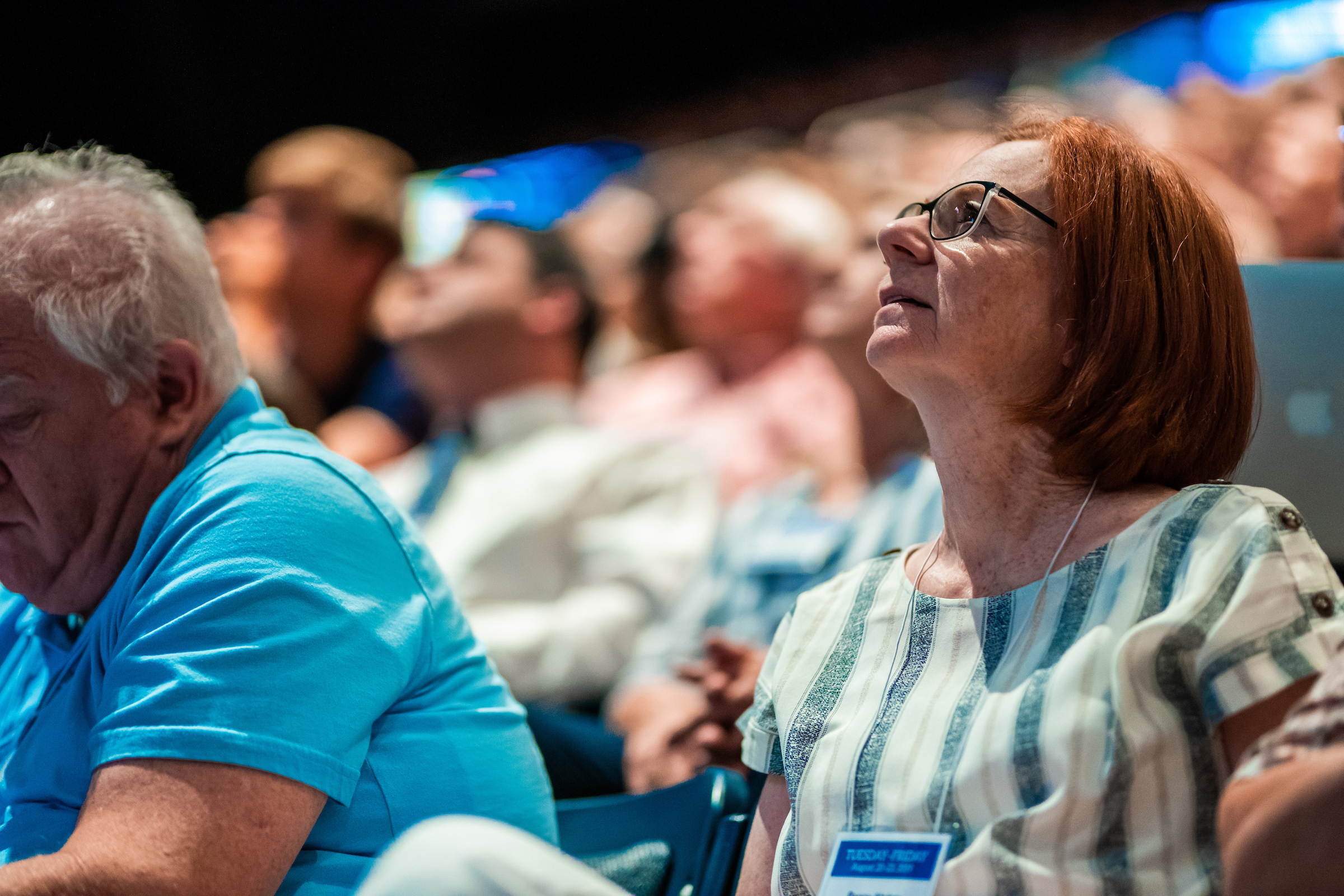 Education Week attendees listen and take notes during devotional at BYU Education Week in Provo, Utah, on Tuesday, Aug. 20, 2019.