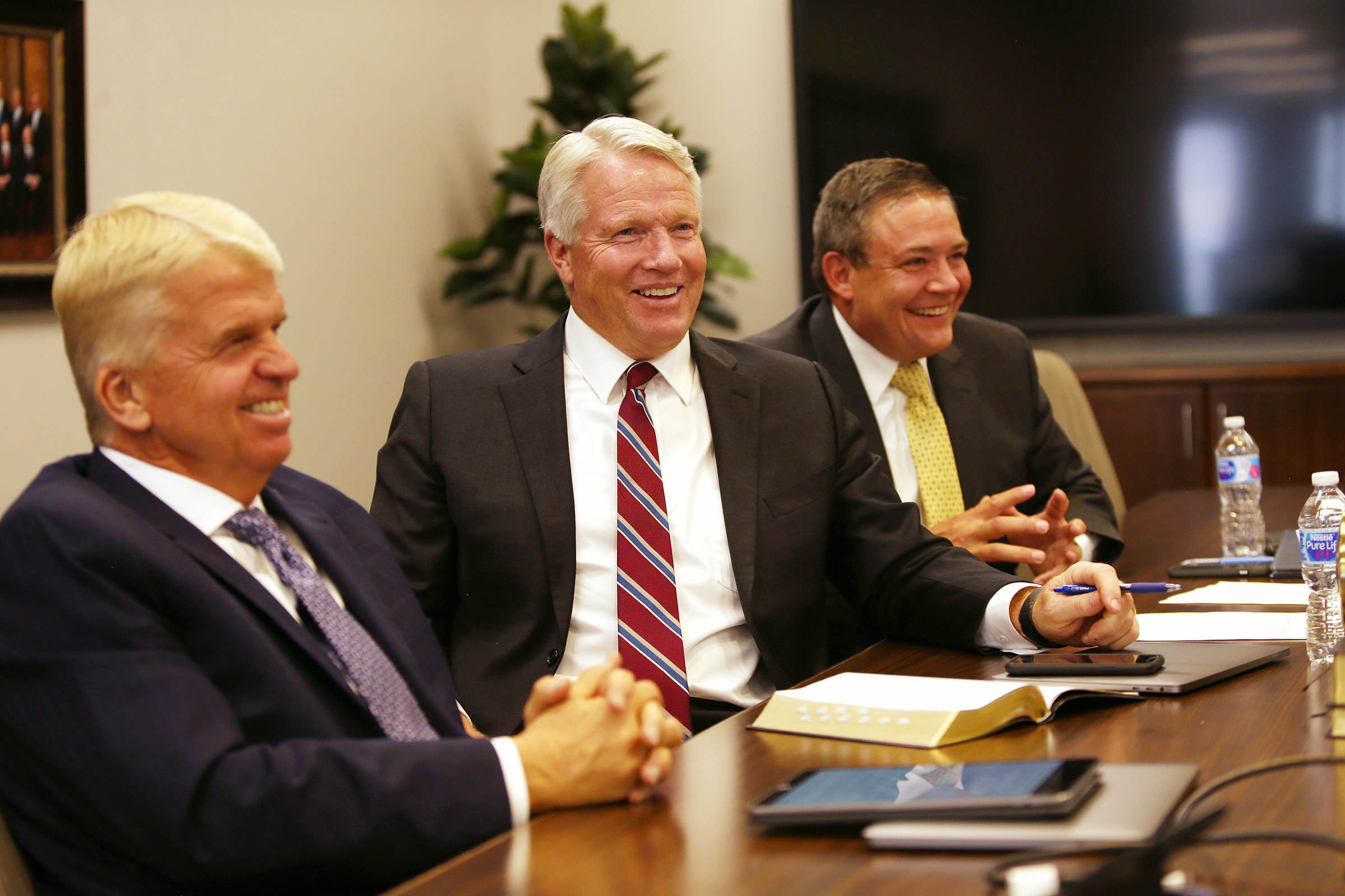 Brother Stephen W. Owen, Brother Douglas D. Holmes and Brother M. Joseph Brough of the Young Men general presidency, enjoy a light moment as they talk with the Young Women general presidency about the development of the 2020 youth theme Tuesday, Aug. 20, 2019, at the Church Office Building in Salt Lake City.