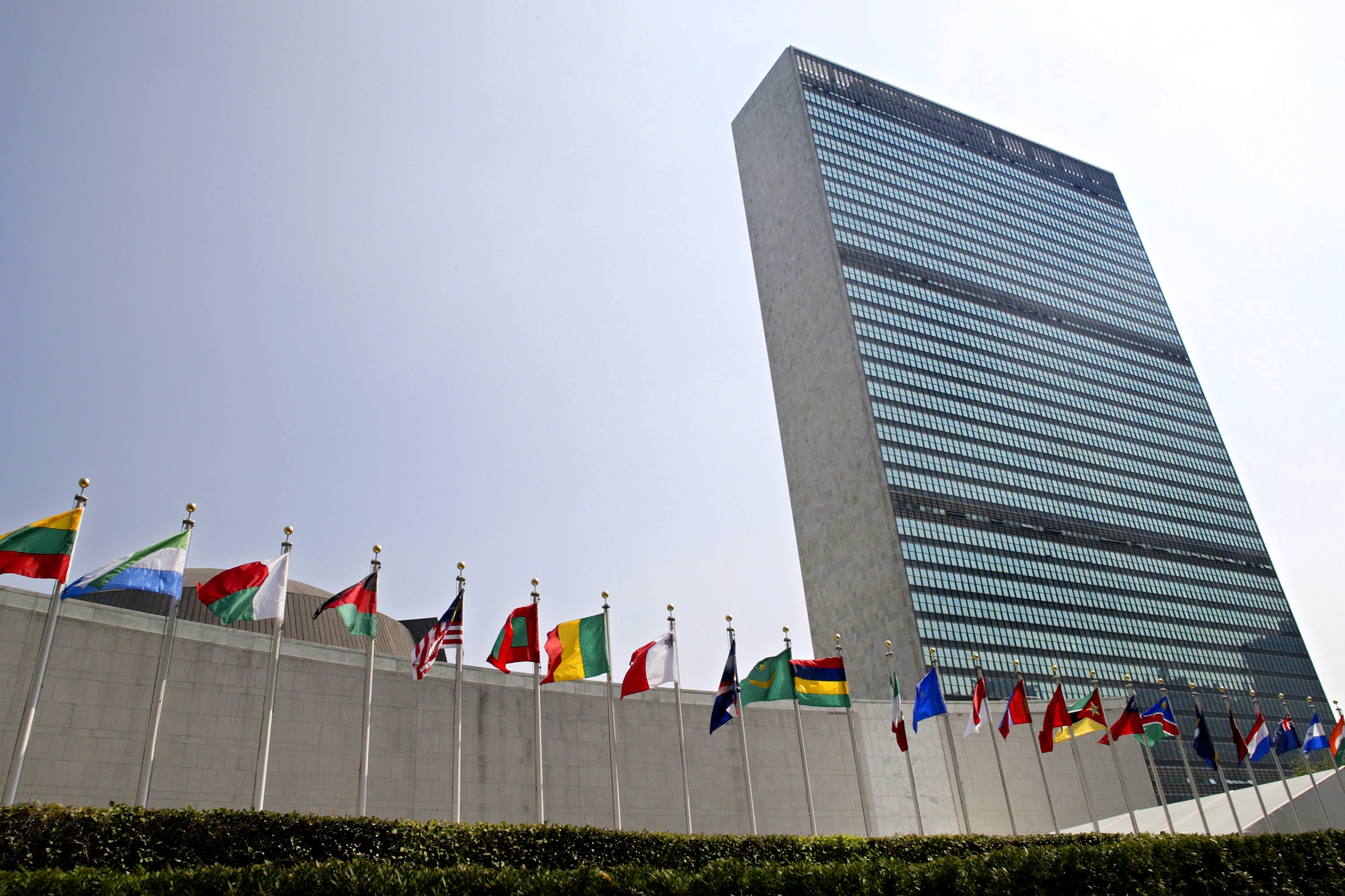 In this Sept. 13, 2005, file photo, the flags of member nations fly outside the General Assembly building at the United Nations headquarters in New York. (Adam Rountree, Associated Press)