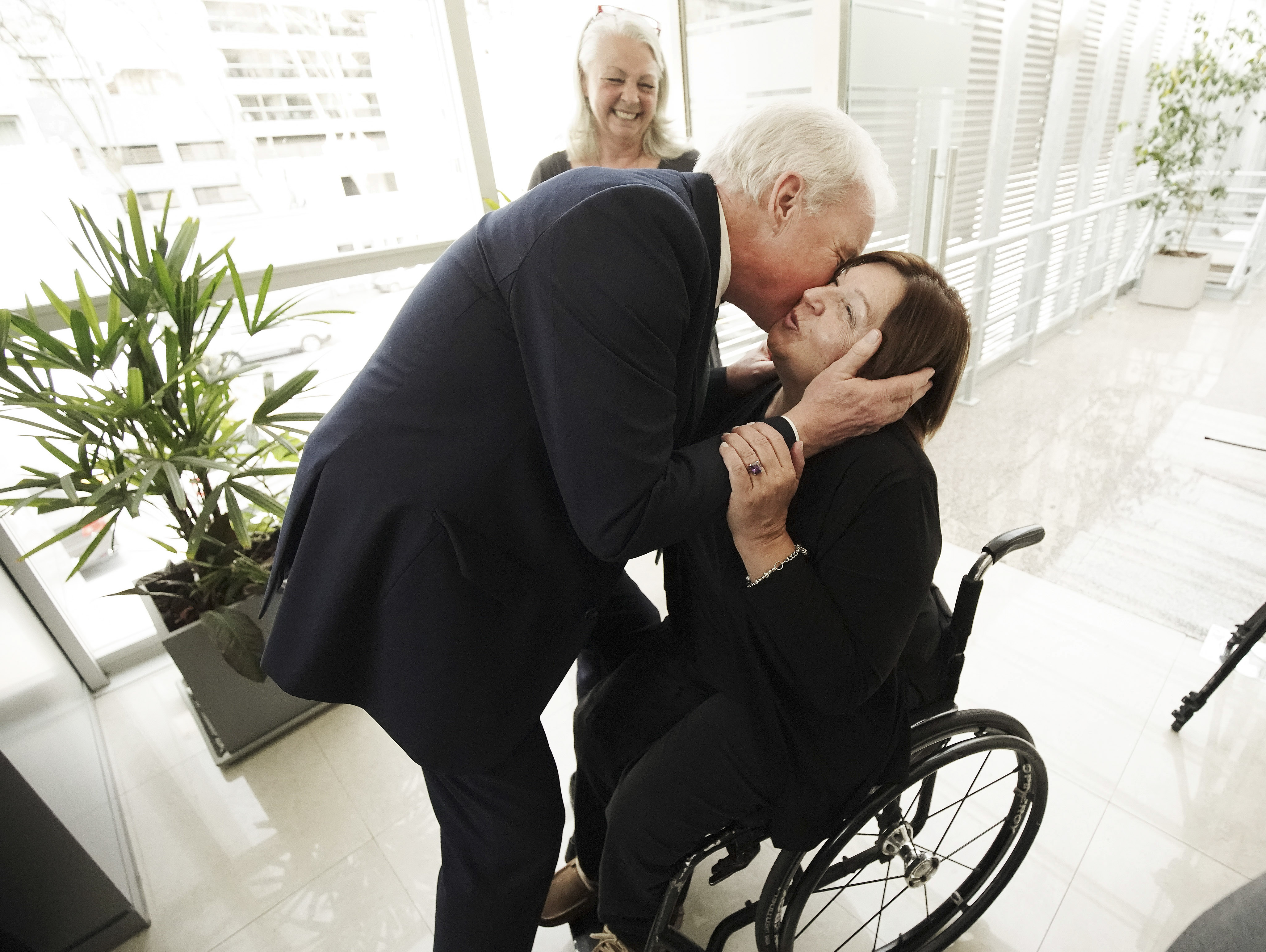 Elder Kent Burton kisses Silvia Carranza, president of CILSA, as Latter-day Saint Charities donated wheelchairs to recipients through CILSA in Buenos Aires, Argentina, on Wednesday, Aug. 28, 2019.