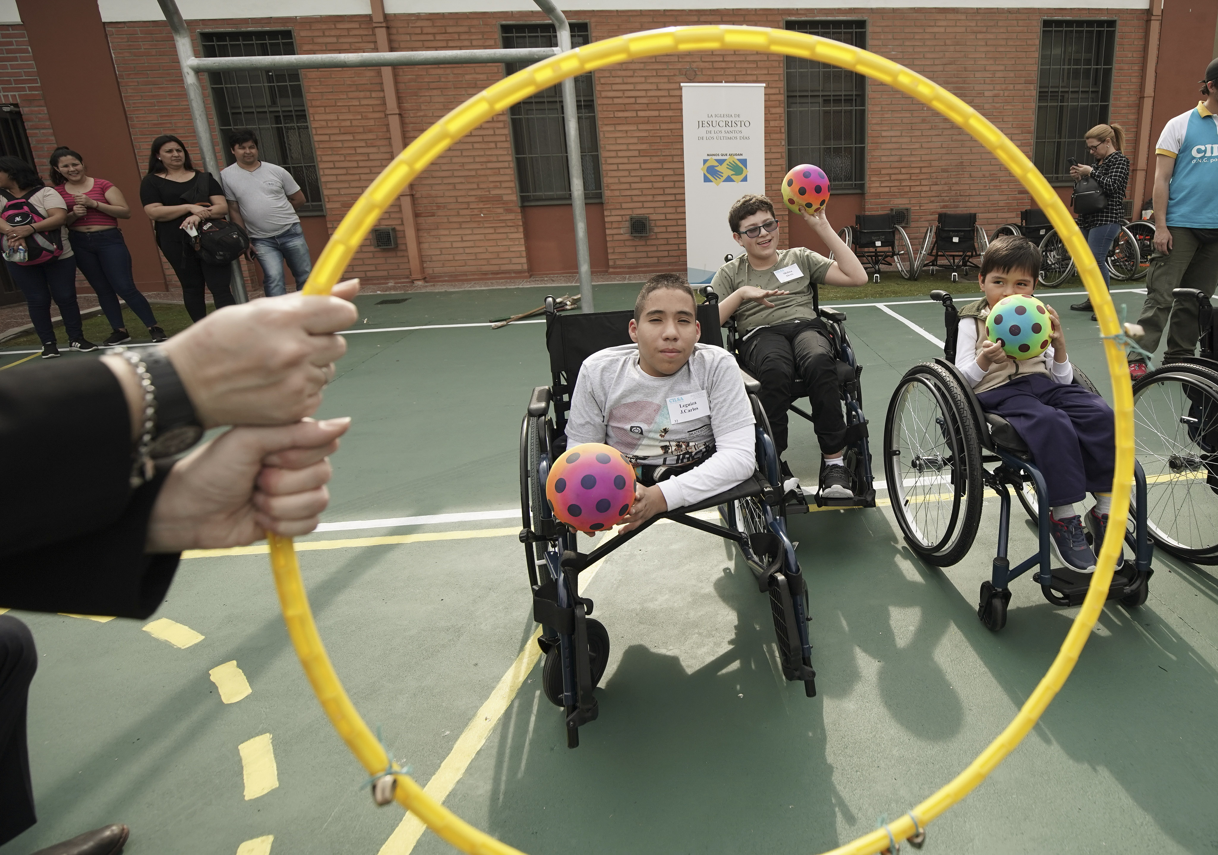 Juan Carlos Loza plays a game after Latter-day Saint Charities donated a wheelchair to him at the Villa Urquiza Ward meetinghouse in Buenos Aires, Argentina, on Wednesday, Aug. 28, 2019.