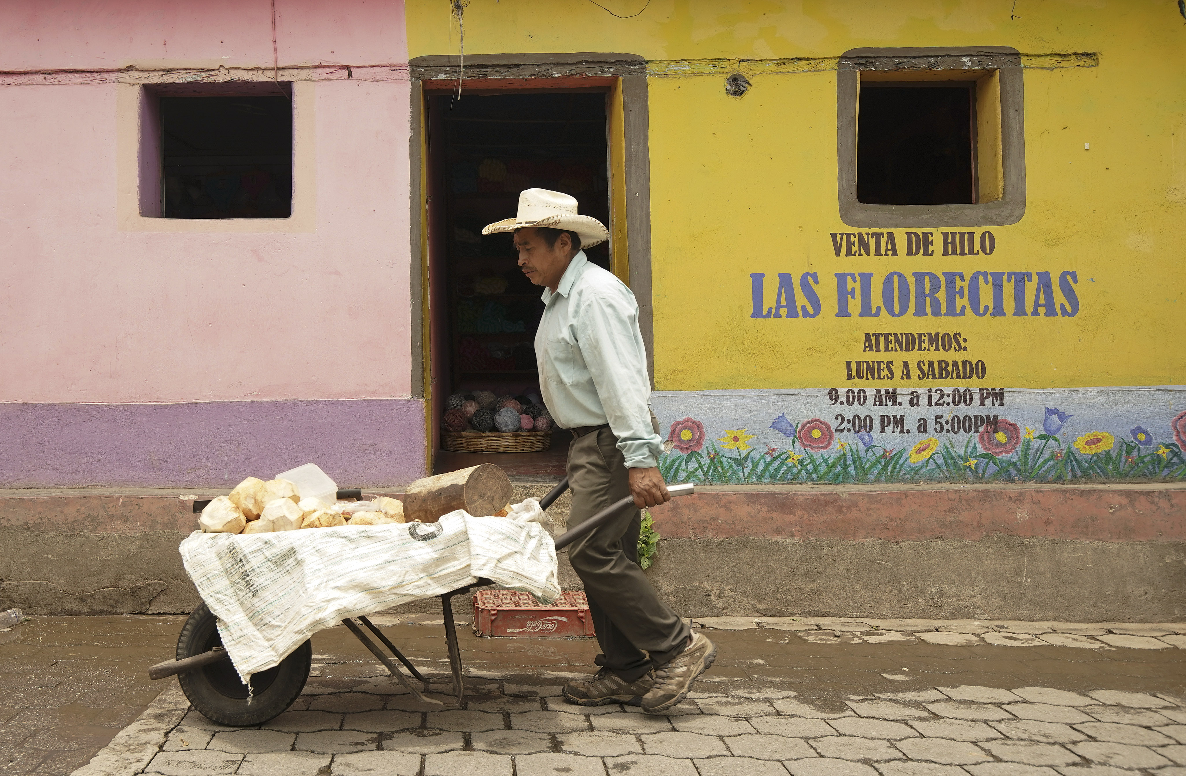 A man sells coconuts in San Cruz, Guatemala, on Monday, Aug. 19, 2019. President Russell M. Nelson of The Church of Jesus Christ of Latter-day Saints spoke in a devotional on Saturday, Aug. 24 in Guatemala City.