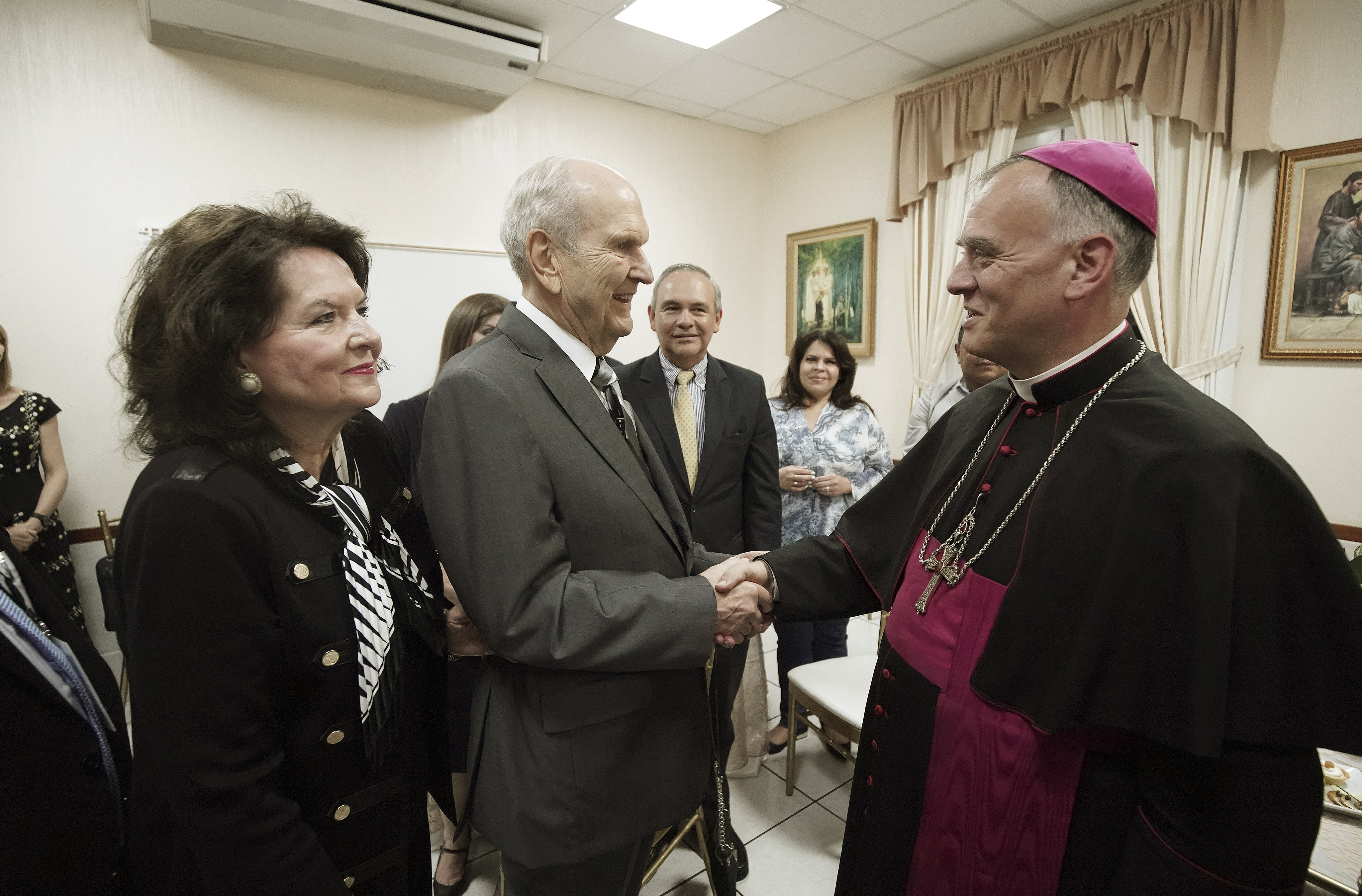 President Russell M. Nelson of The Church of Jesus Christ of Latter-day Saints and his wife, Sister Wendy Nelson, meet with Archbishop Henry Marie Denis Thevenin prior to a devotional in Guatemala City on Saturday, Aug. 24, 2019.