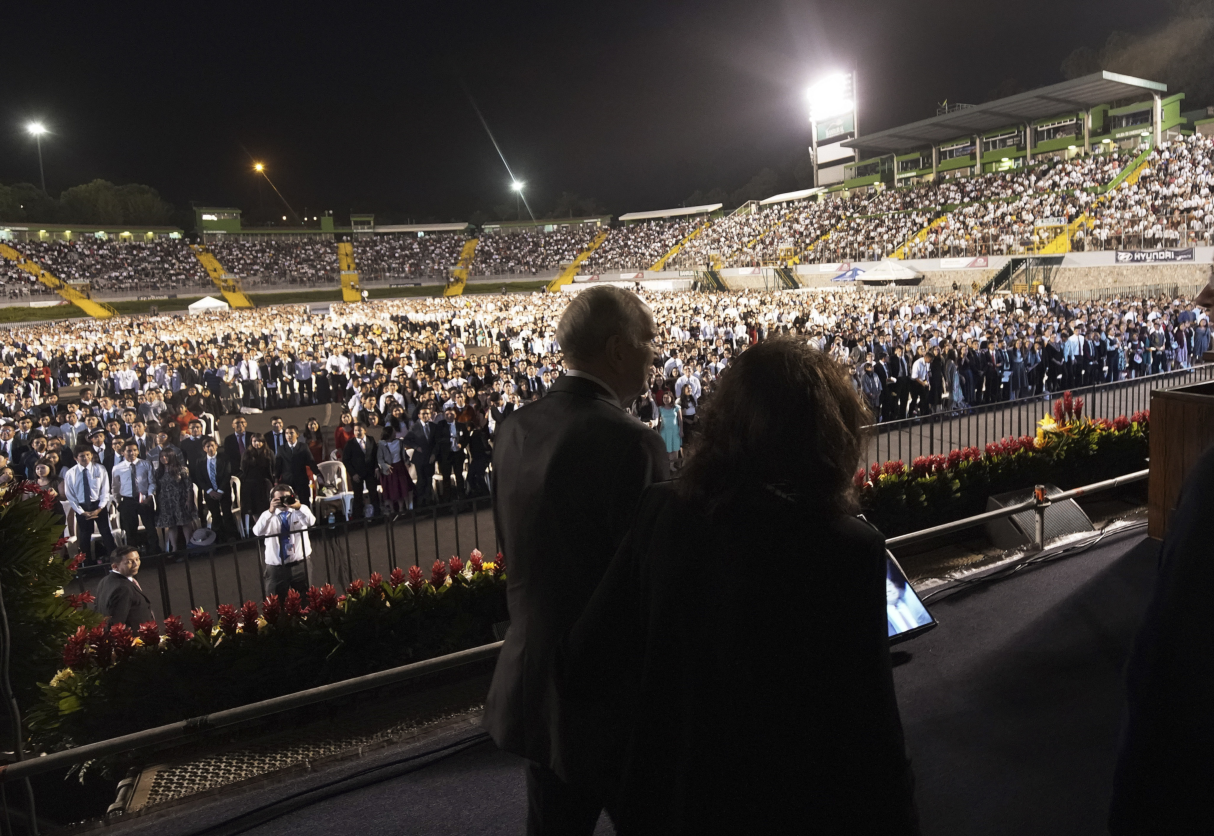 President Russell M. Nelson of The Church of Jesus Christ of Latter-day Saints and his wife Sister Wendy Nelson take the stage during a devotional at Estadio Cementos Progreso stadium in Guatemala City on Saturday, Aug. 24, 2019.