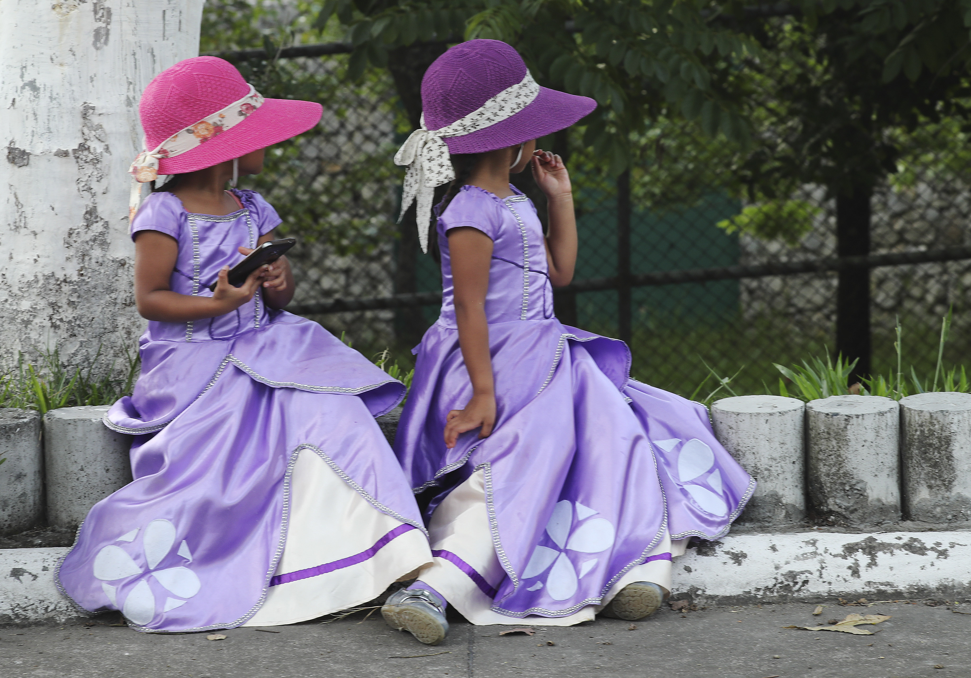 Tow young girls wait for the devotional at Estadio Cementos Progreso stadium in Guatemala City on Aug. 24, 2019.
