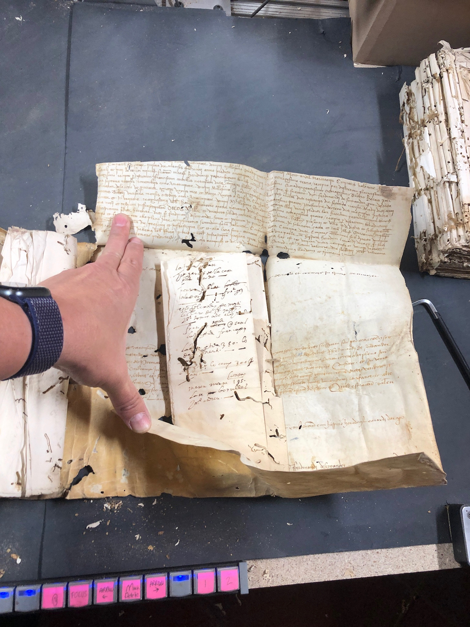 Covers that hold books together are often documents as well and are older than the actual book. Senior missionaries Sister Rife and Sister Klafke are currently serving in Spain on a records preservation mission.
