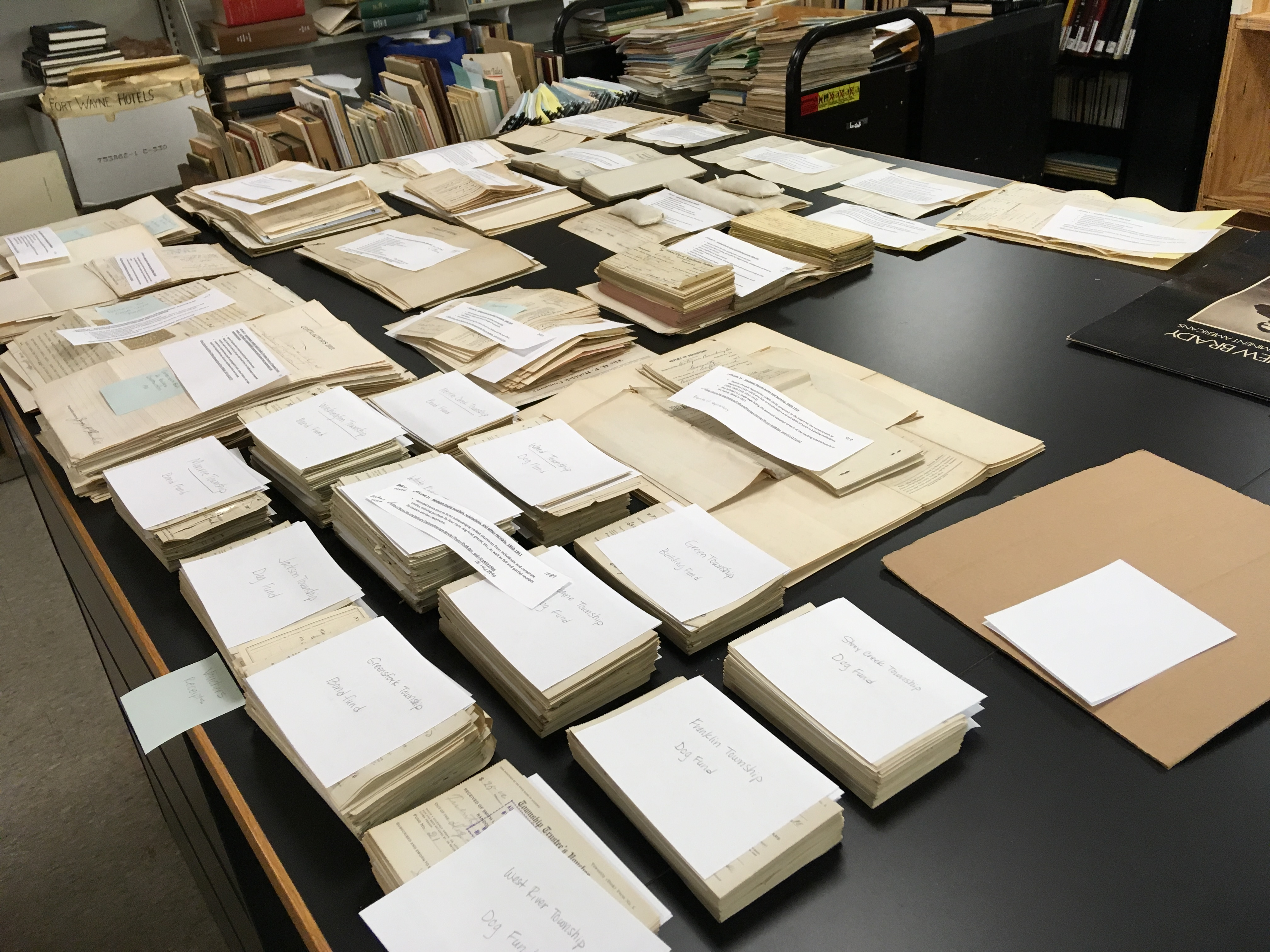 Piles of documents are ready to be scanned at the Allen County Public Library in Fort Wayne, Indiana. The Taylors served a records preservation with their disabled adult son in the Indianapolis Indiana Mission. Photo courtesy of Rosalie Taylor.
