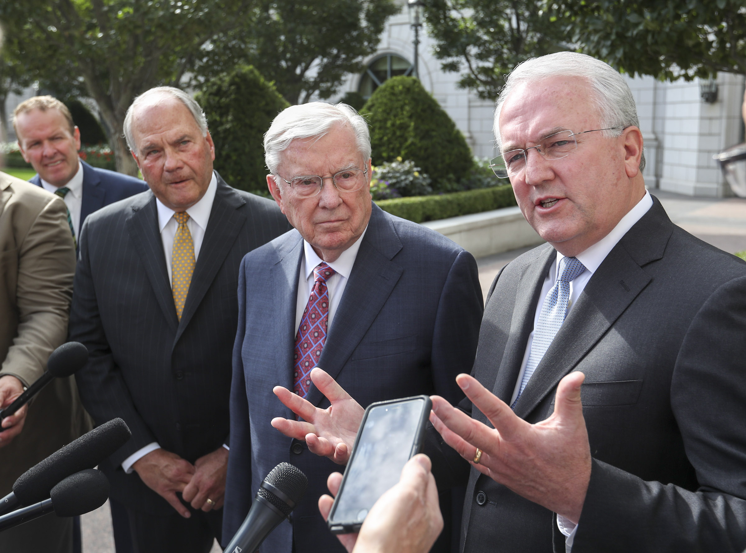President M. Russell Ballard, center, acting president of the Quorum of the Twelve Apostles, and Elder Ronald A. Rasband, a member of the Quorum of the Twelve Apostles, left, listen as Elder Jack N. Gerard, a General Authority Seventy, right, speaks to members of the media following a meeting with Vice President Mike Pence at the Grand America Hotel in Salt Lake City on Thursday, Aug. 22, 2019.