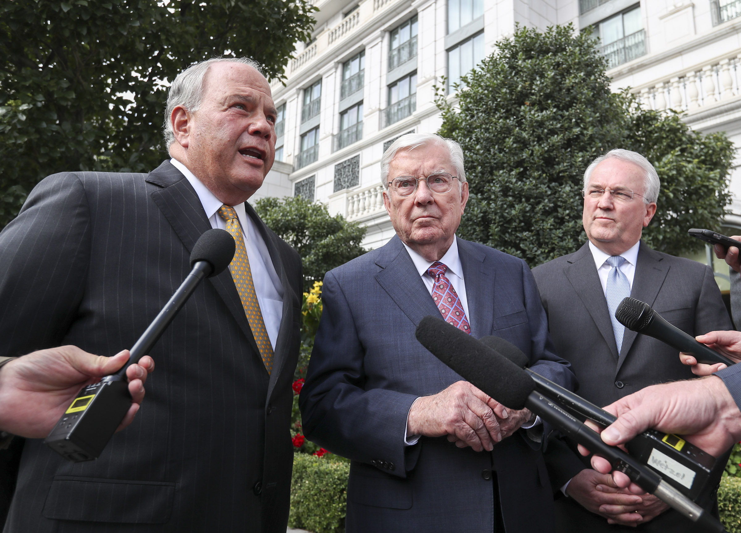 Elder Ronald A. Rasband, a member of the Quorum of the Twelve Apostles, left, speaks as President M. Russell Ballard, acting president of the Quorum of the Twelve Apostles, center, and Elder Jack N. Gerard, a General Authority Seventy, right, listen following a meeting with Vice President Mike Pence at the Grand America Hotel in Salt Lake City on Thursday, Aug. 22, 2019.