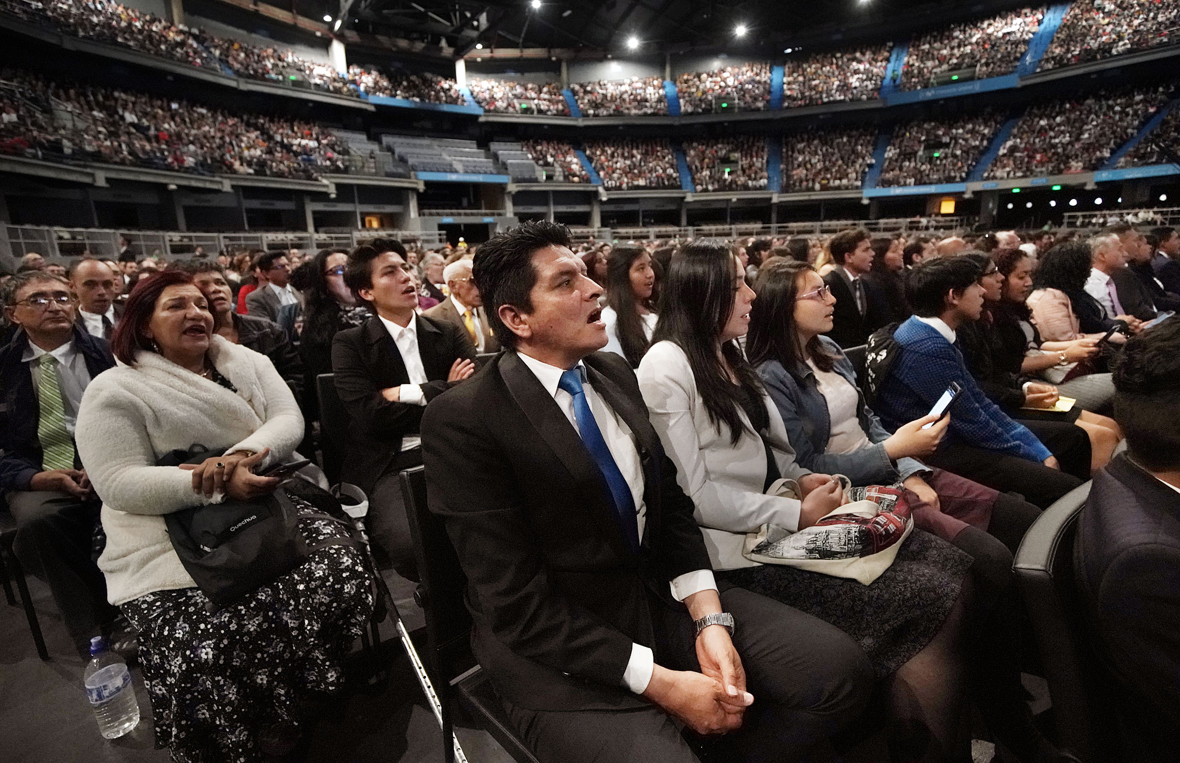 Manuel Pardo joins with his family and those in attendance in singing during a Latin America Ministry Tour devotional in Bogota, Colombia on Sunday, Aug. 25, 2019.