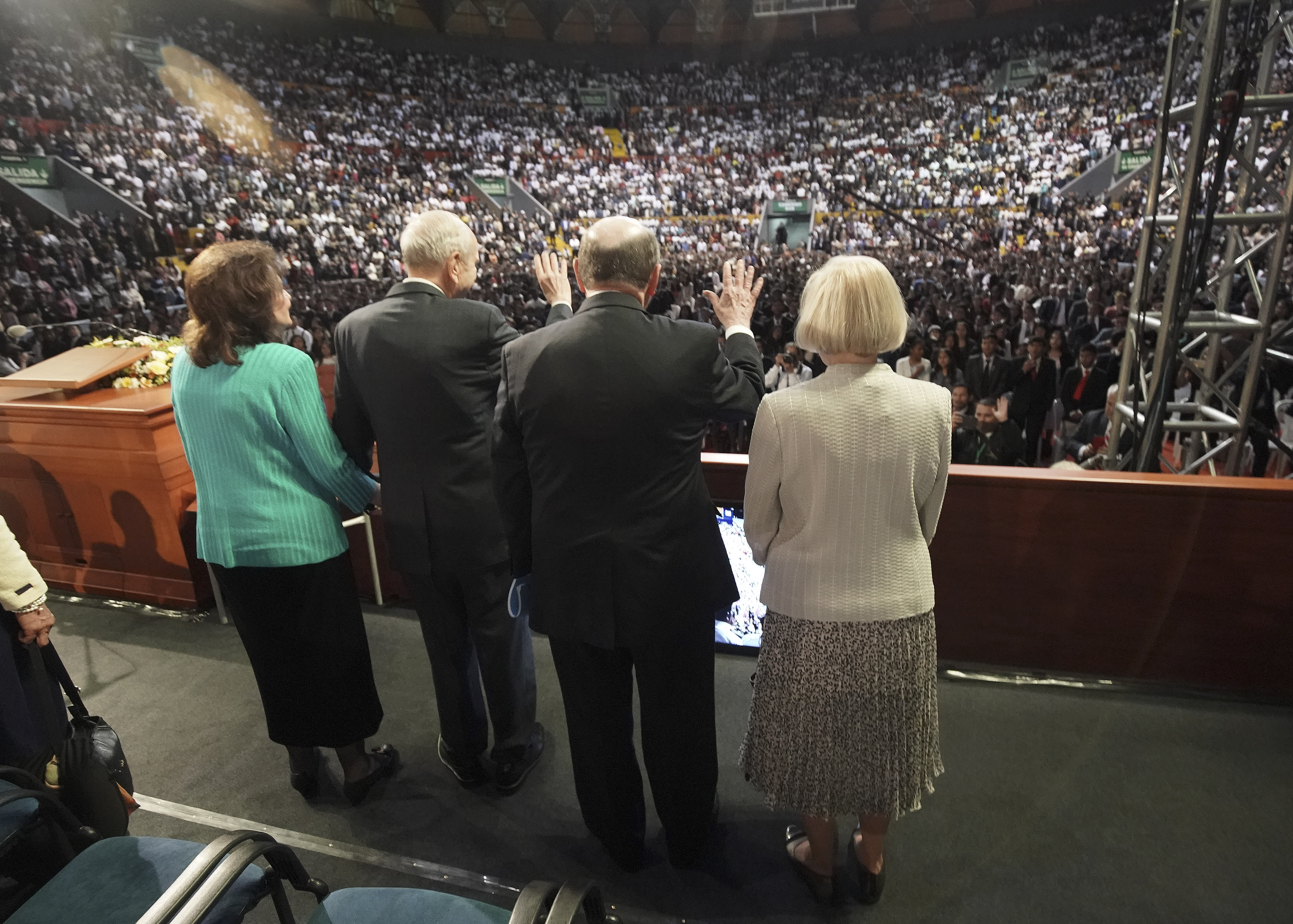 President Russell M. Nelson of The Church of Jesus Christ of Latter-day Saints and his wife, Sister Wendy Nelson, and Elder Quentin L. Cook of the Quorum of the Twelve Apostles and his wife, Sister Mary Cook, wave to attendees after a devotional in Quito, Ecuador, on Monday, Aug. 26, 2019.