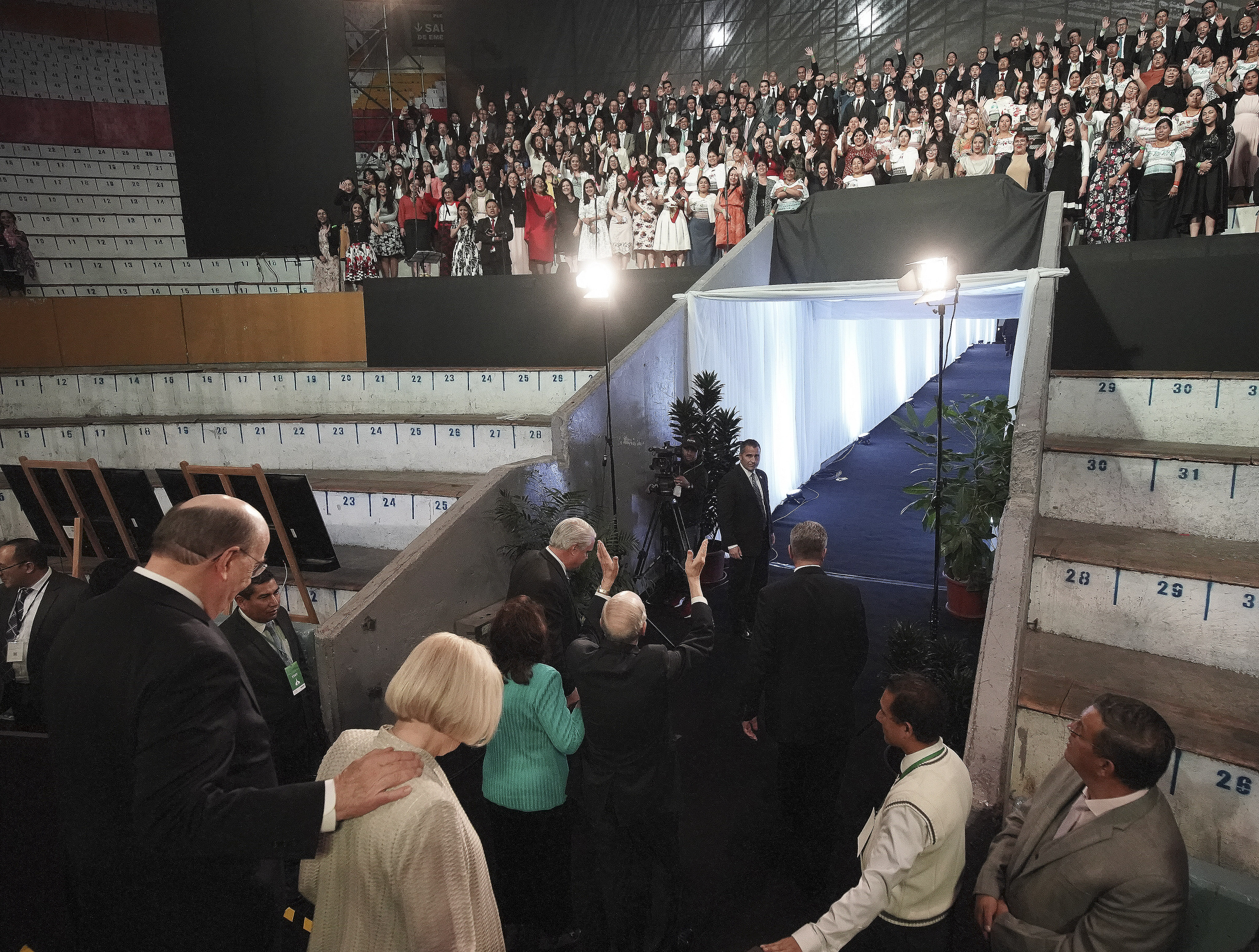 President Russell M. Nelson of The Church of Jesus Christ of Latter-day Saints waves to the choir after a devotional in Quito, Ecuador, on Monday, Aug. 26, 2019.