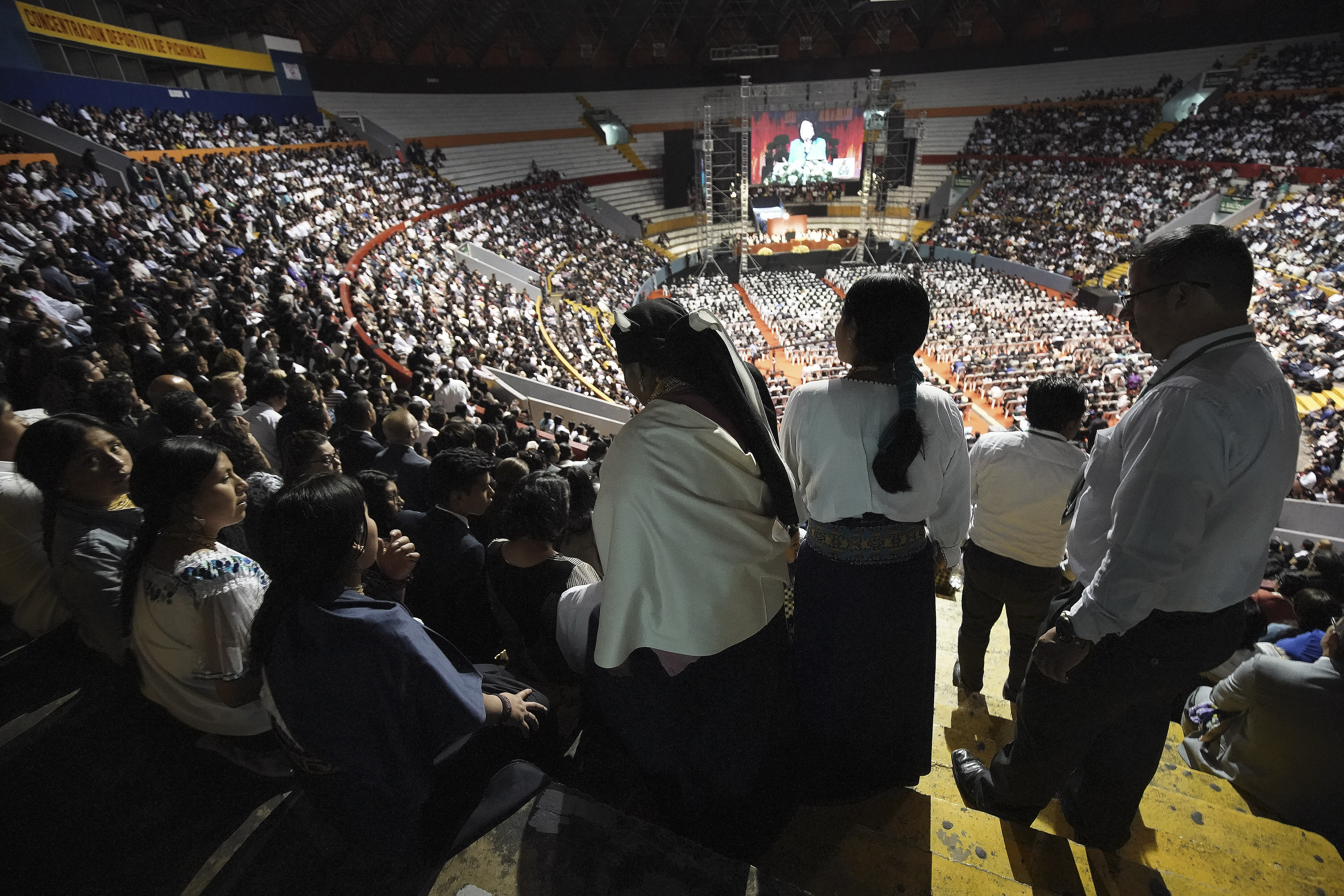 Attendees enter the arena during a devotional in Quito, Ecuador, on Monday, Aug. 26, 2019.
