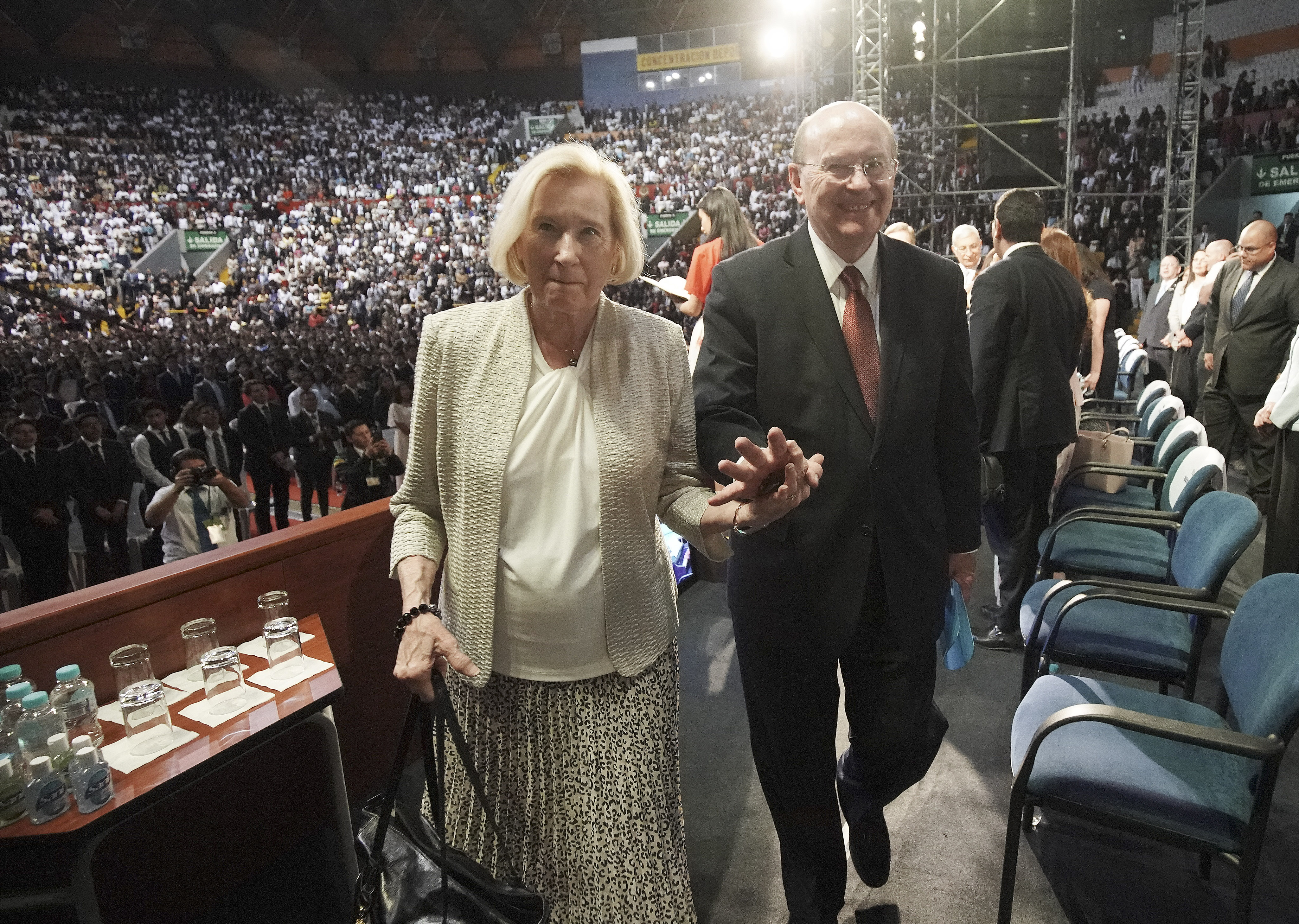 Elder Quentin L. Cook, of the Quorum of the Twelve Apostles of The Church of Jesus Christ of Latter-day Saints, and his wife, Sister Mary Cook, leave the stand after a devotional in Quito, Ecuador, on Monday, Aug. 26, 2019.