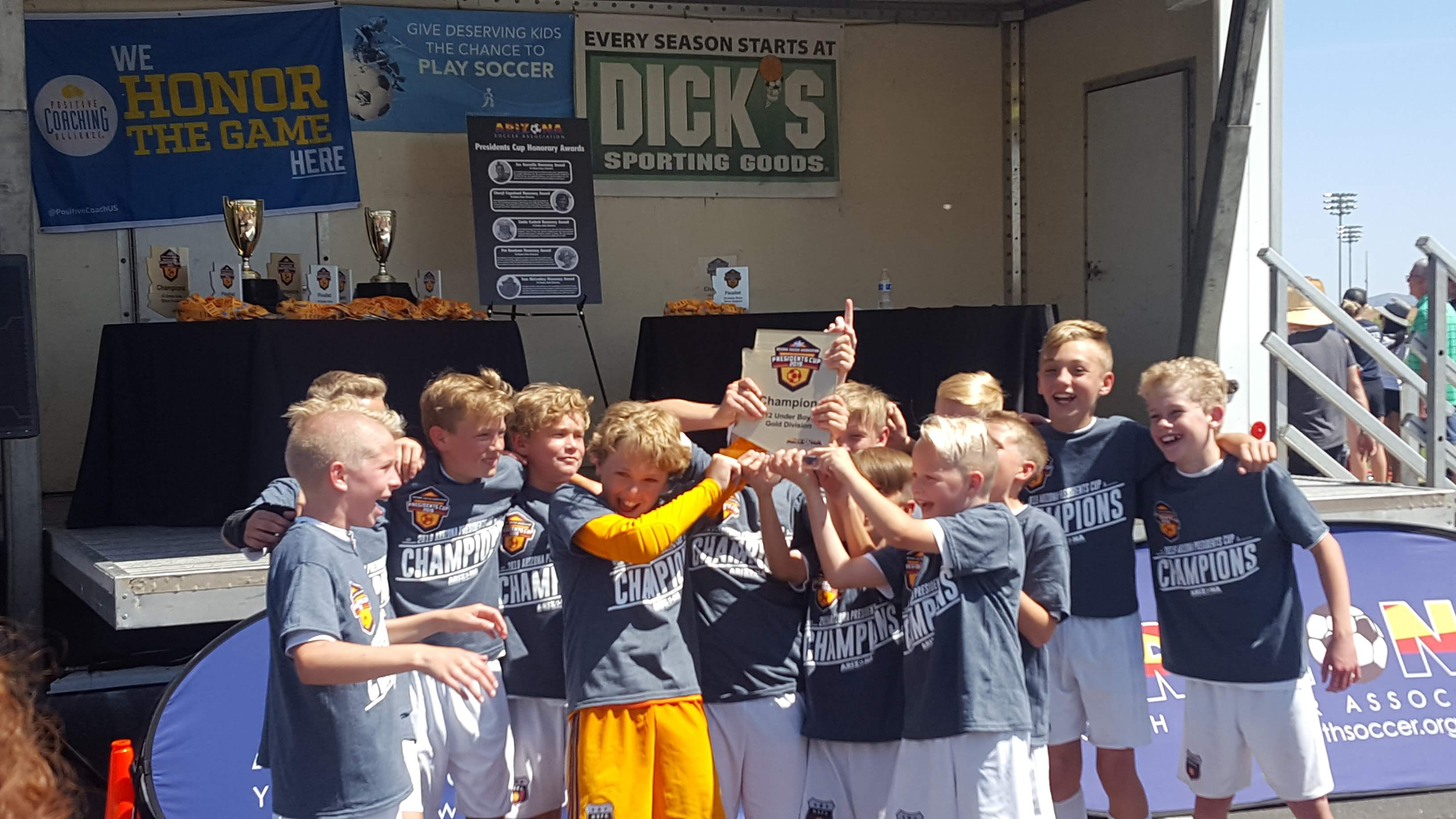 The 2007 Boys Blue soccer team holds up the trophy after winning the Arizona President's Cup Tournament in April 2019 in Phoenix.