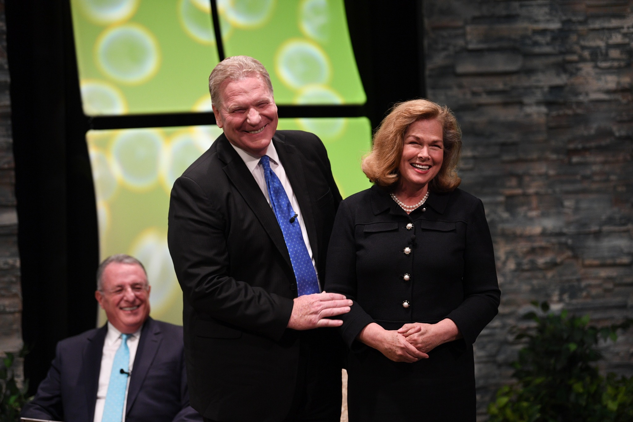 Elder Craig C. Christensen of the Seventy introduces his wife, Debbie, to the young adult audience at the Worldwide Devotional Face to Face broadcast on Sunday, Sept. 15, 2019, in Provo, Utah.