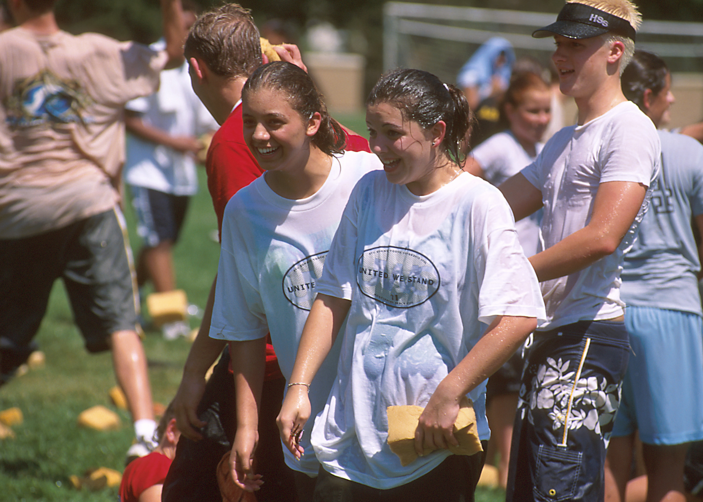 Young people get wet during an activity at Especially for Youth in 2000.