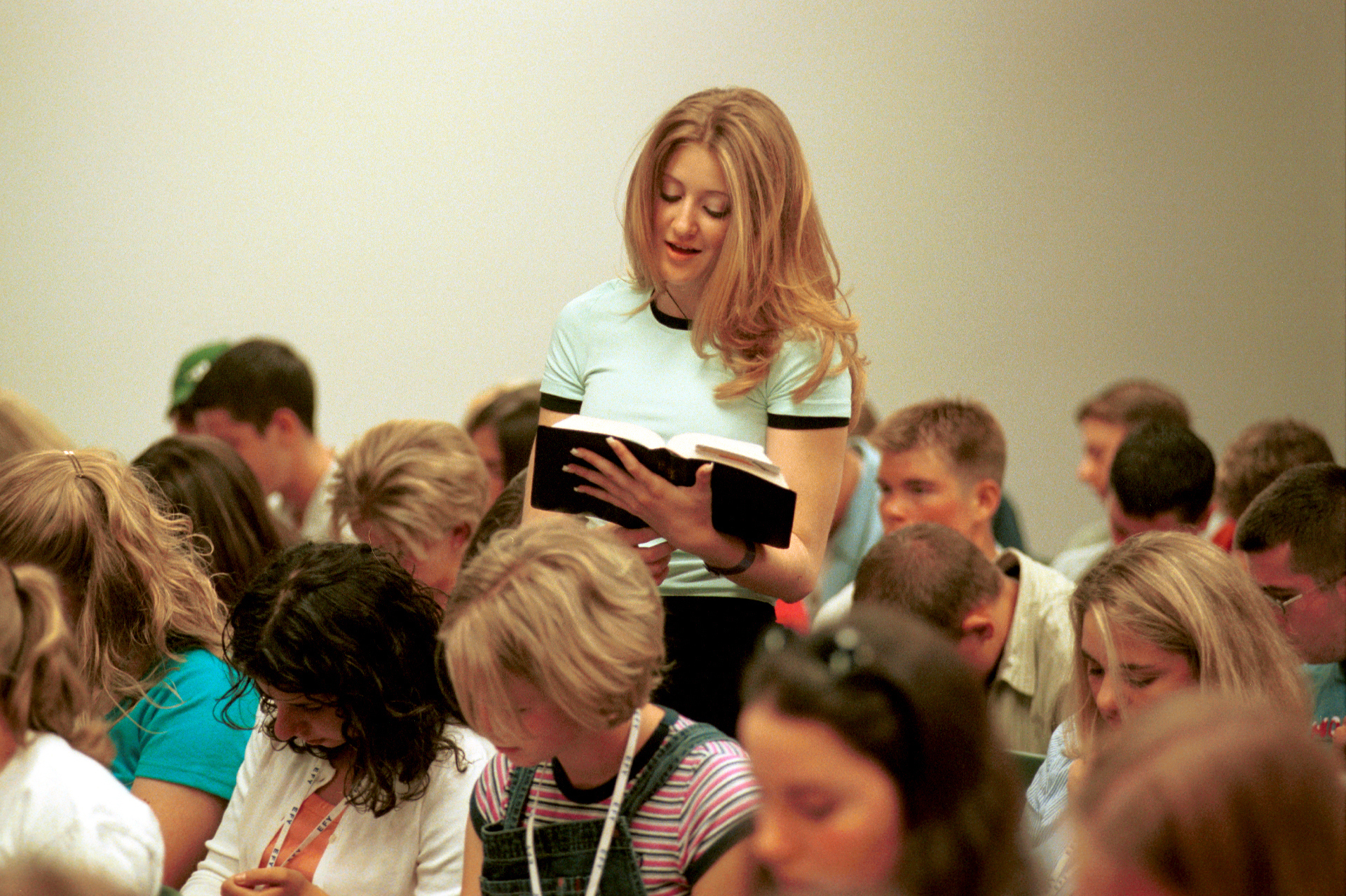 A young woman reads a scripture during a class at Especially for Youth in 2000.