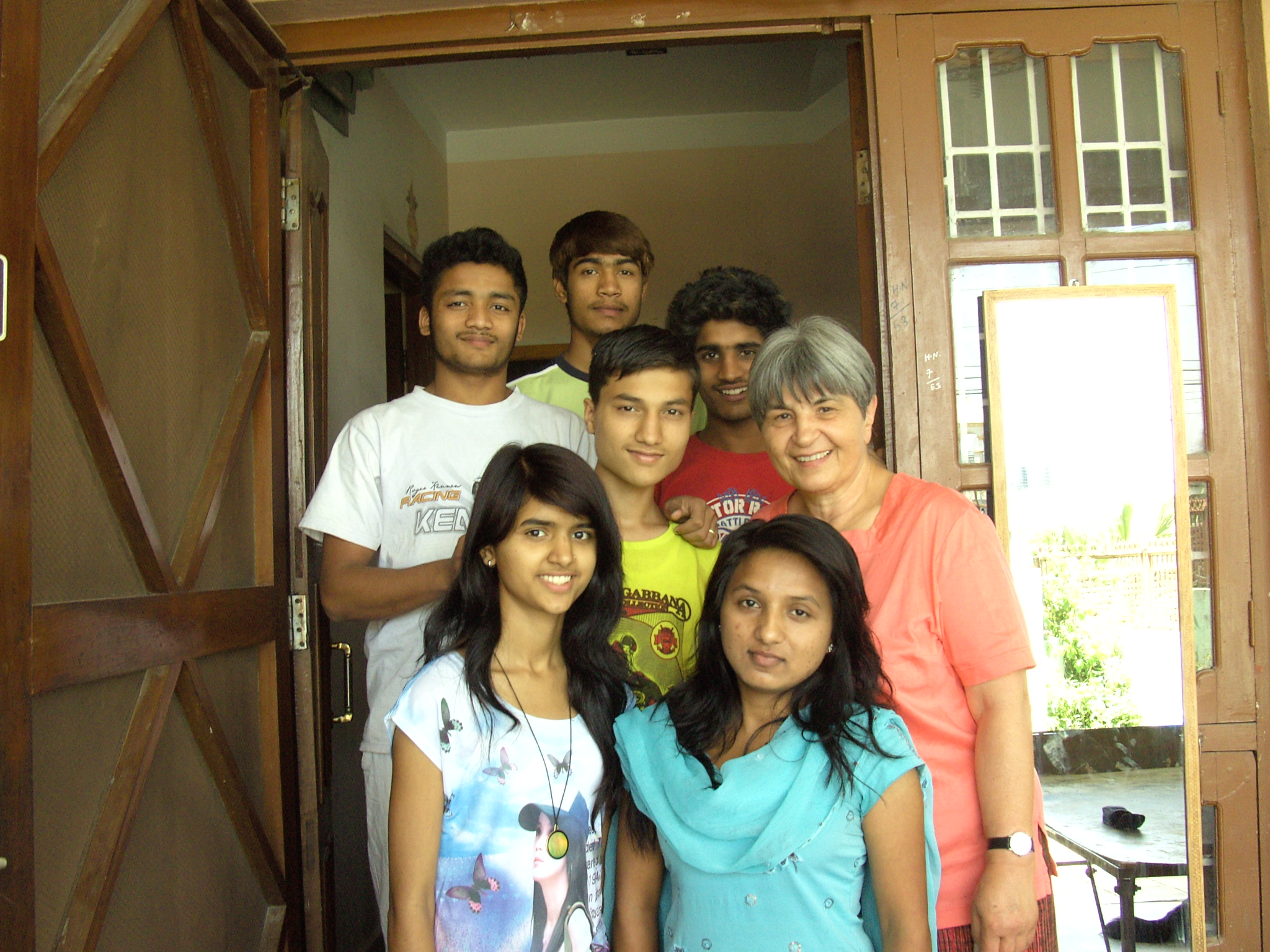 Ellen Dietrich poses with some of the older children from her Home of Hope in Kathmandu, Nepal in 2013.