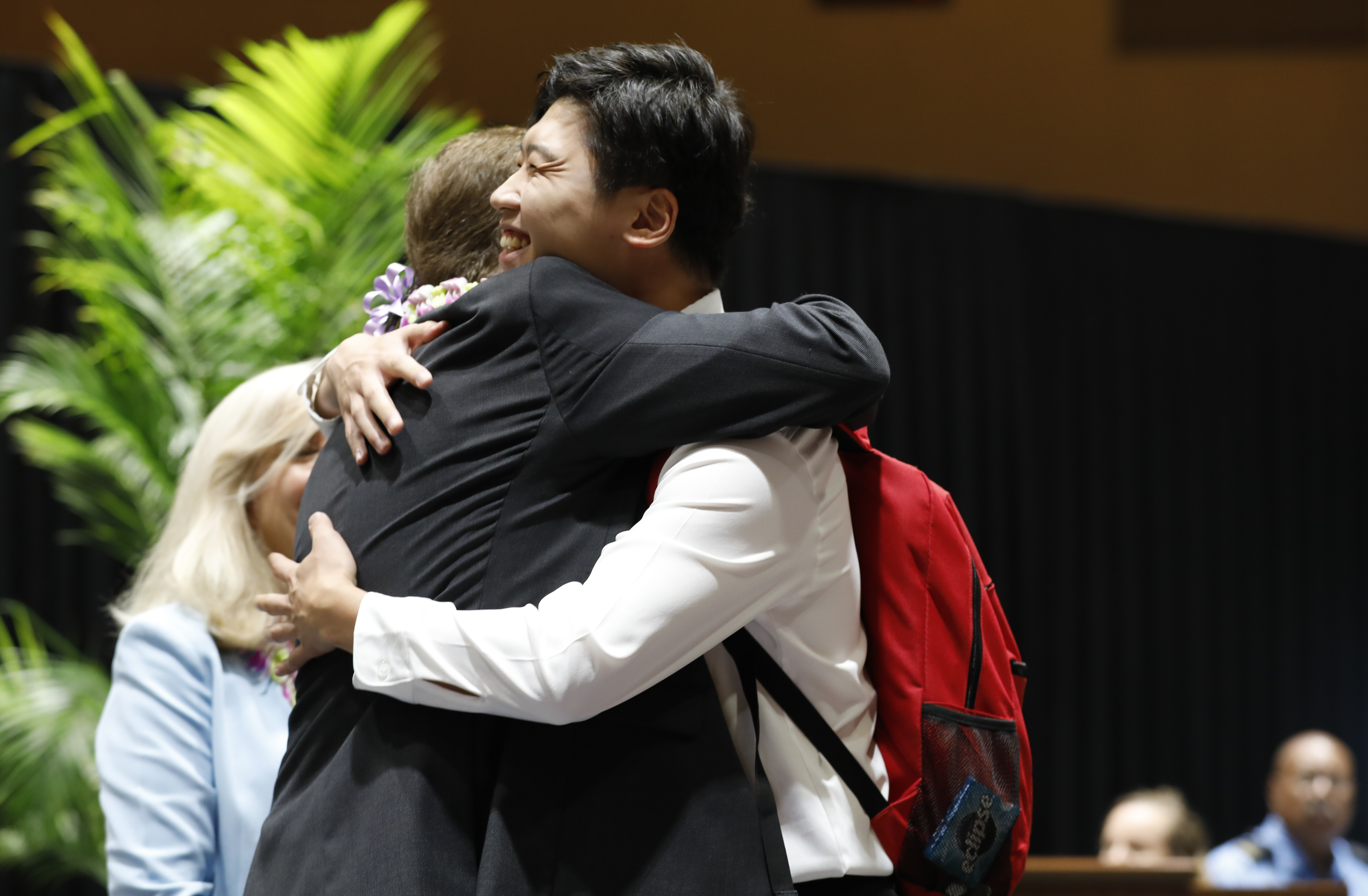 Elder L. Todd Budge embraces Gyujin Han, a BYU-Hawaii student from South Korea. Elder Budge gave the devotional address at BYU-Hawaii on Tuesday, Sept. 24, 2019.