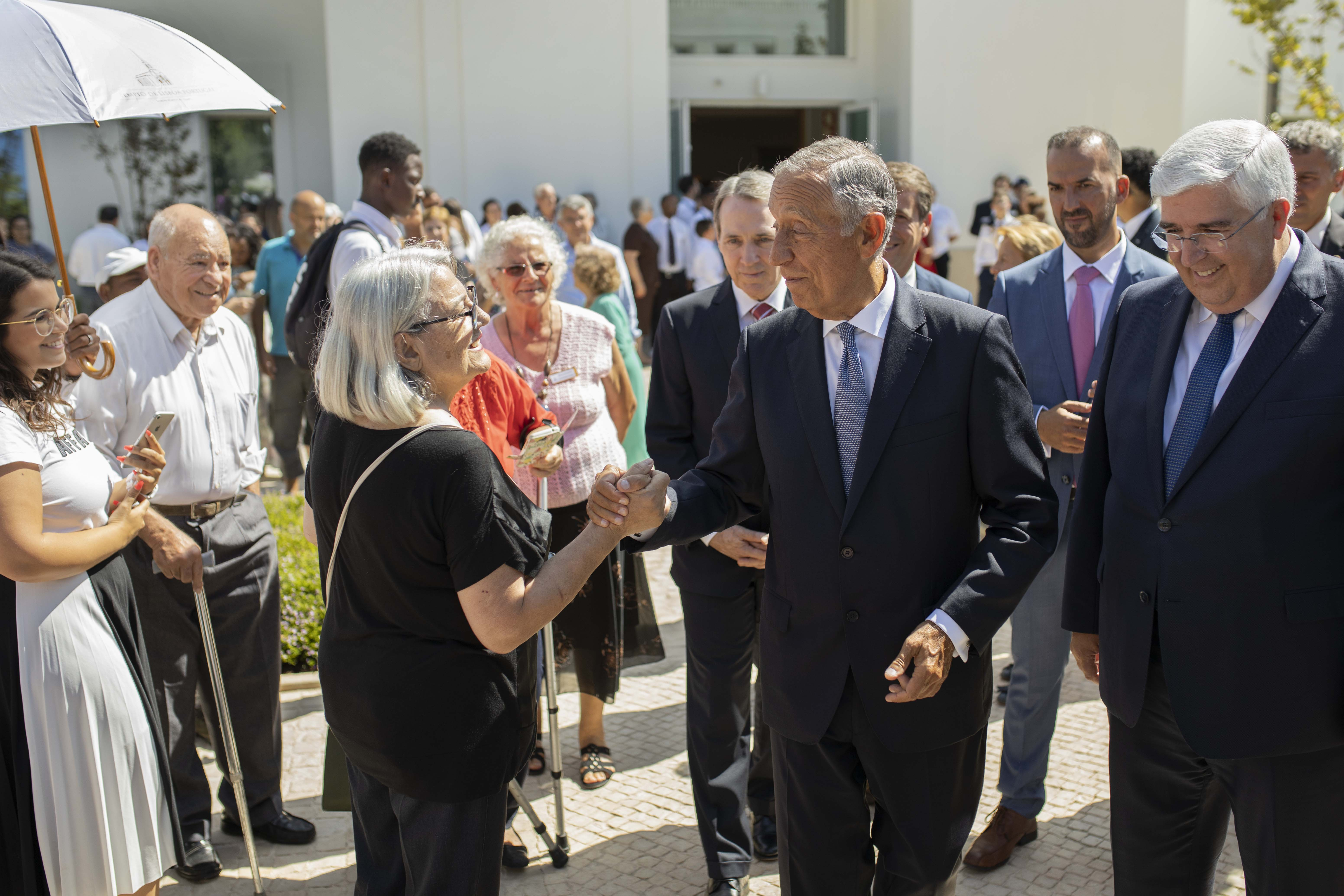 The president of Portugal, Marcelo Rebelo de Sousa, along with several Church leaders, greet members and visitors on the Lisbon Portugal Temple grounds on Aug. 29, 2019.