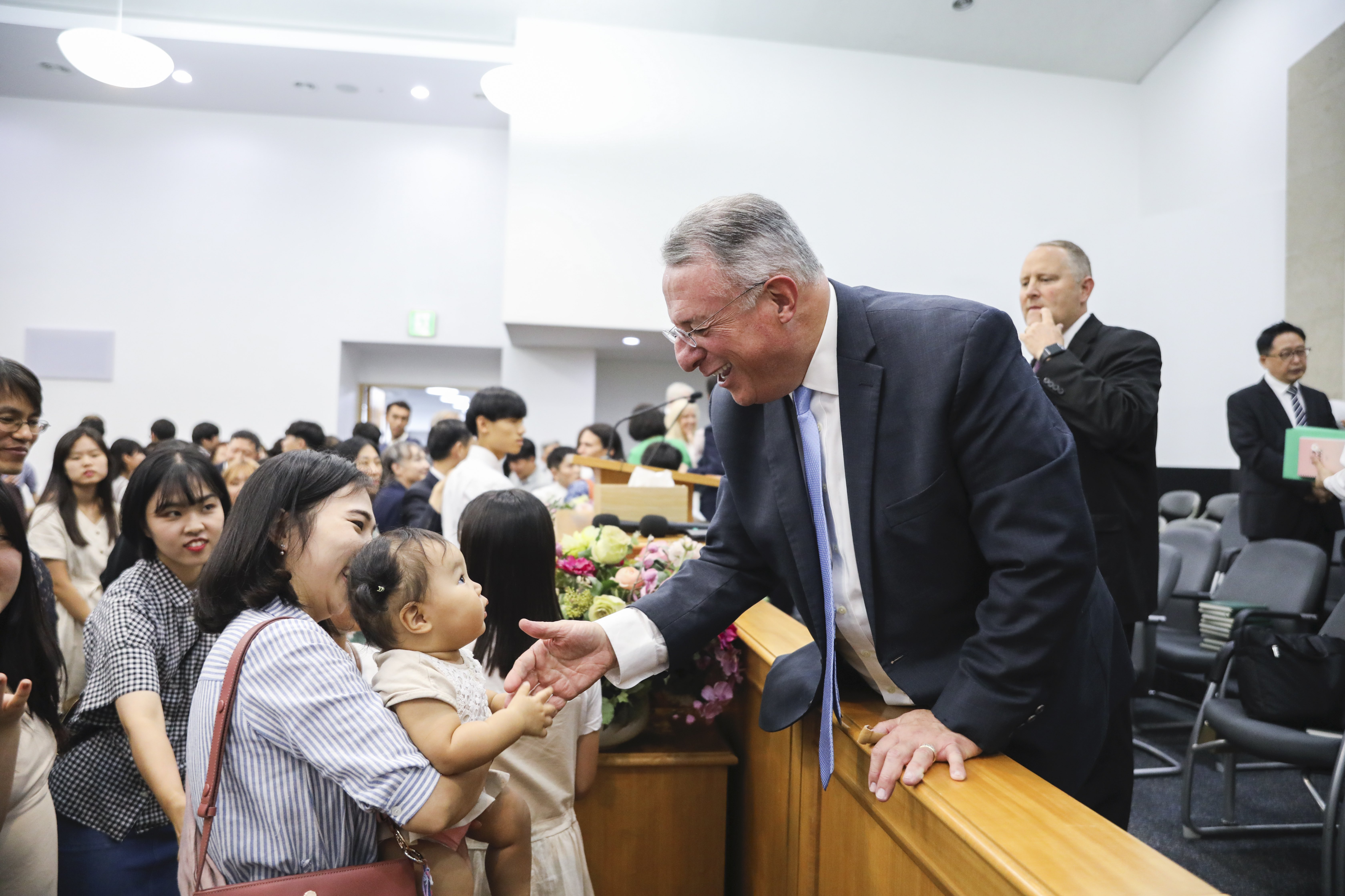 Elder Ulisses Soares greets members after a nationwide member broadcast in Seoul, South Korea, on Sunday, Aug. 25, 2019.