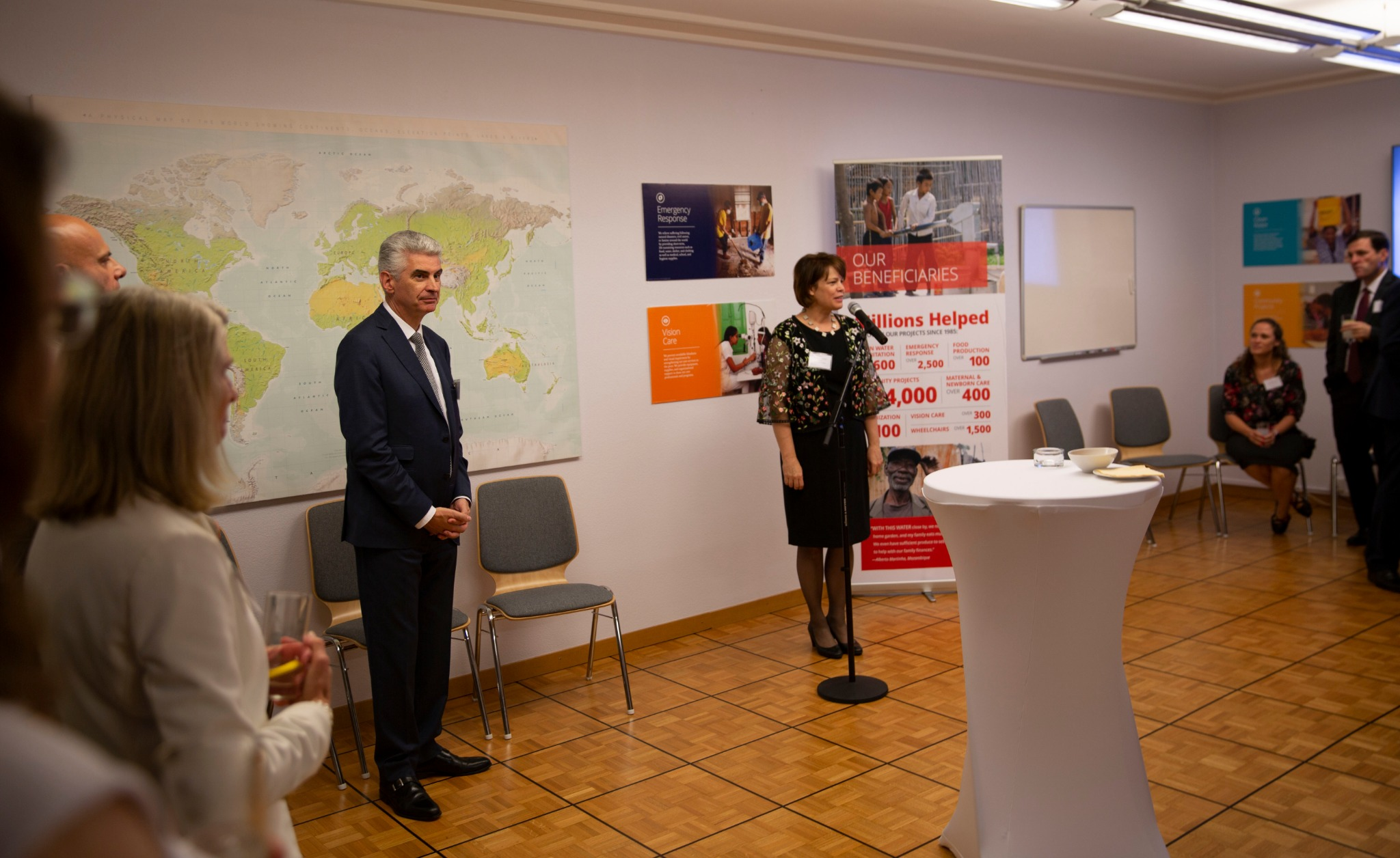 Sister Sharon Eubank, president of Latter-day Saint Charities, explains what the Church charity does for people in need around the world during a reception in Geneva, Switzerland, on Sept. 16, 2019. Presiding Bishop Gerald Caussé is also pictured at left.