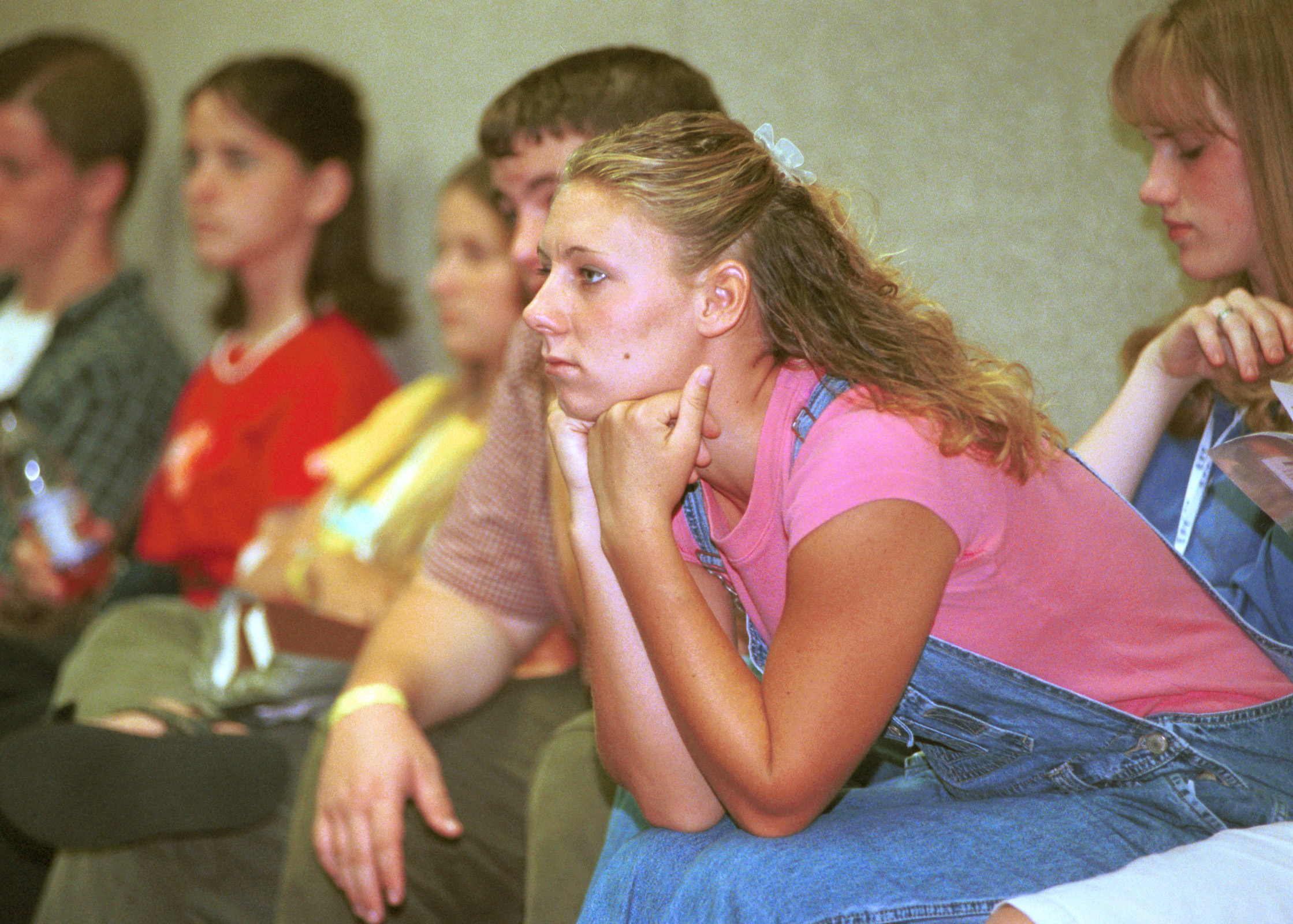 A young woman listens during a class at Especially for Youth in 2000.