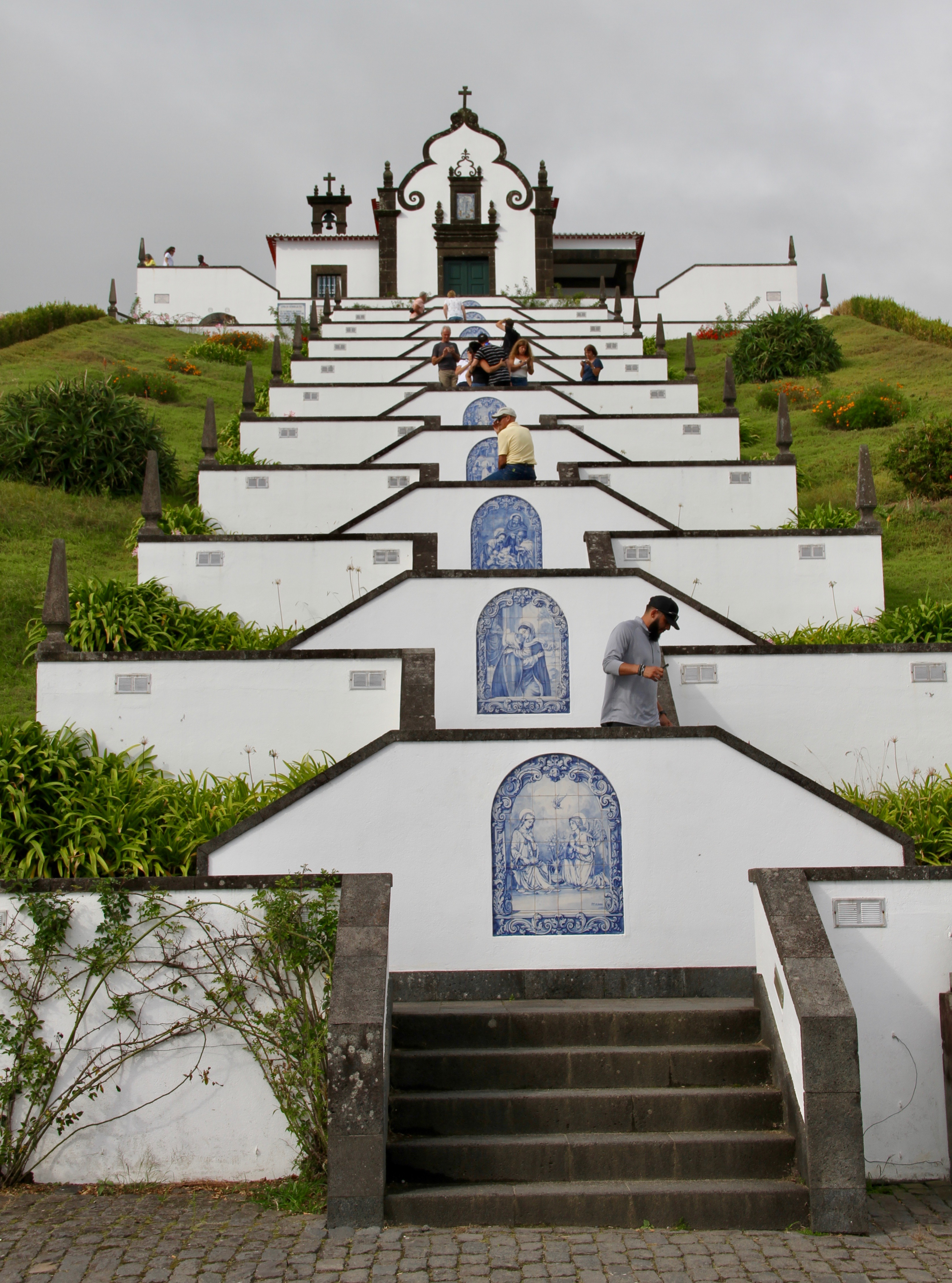 The stairways leading to the Our Lady of Peace (Nossa Senhora da Paz) Church feature tiled illustrations of the life of Jesus Christ. Photo taken Sept. 17, 2019, above Vila Franca do Campo, São Miguel Island of the Azores.