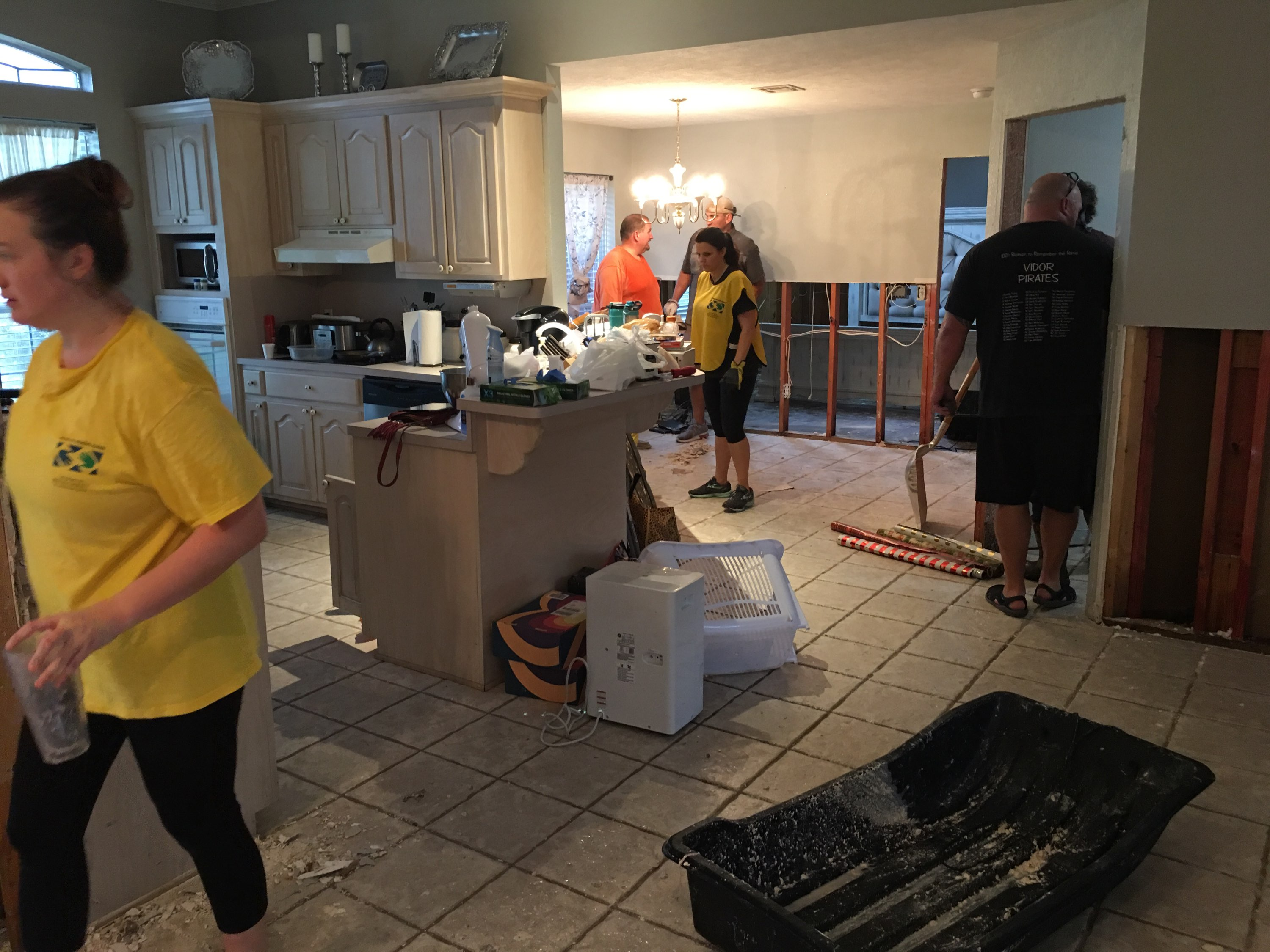 Church members and volunteers wearing Helping Hands t-shirts and vests help to clean up homes in the greater Houston, Texas, area with flood damage from Tropical Storm Imelda, which made landfall on Sept. 19, 2019.