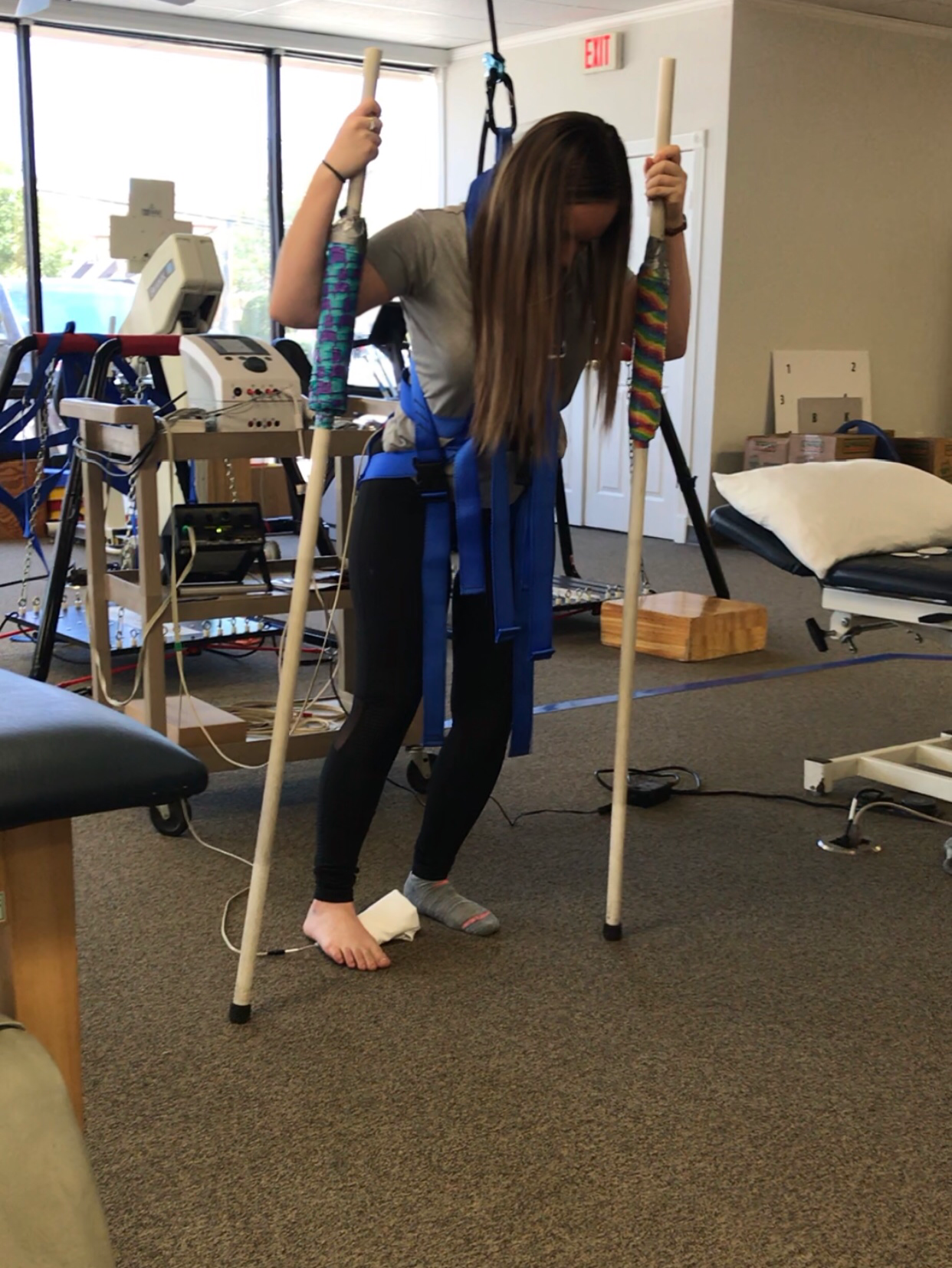 Monique McDown in physical therapy after she was in an accident while serving her mission in Curitiba, Brazil.