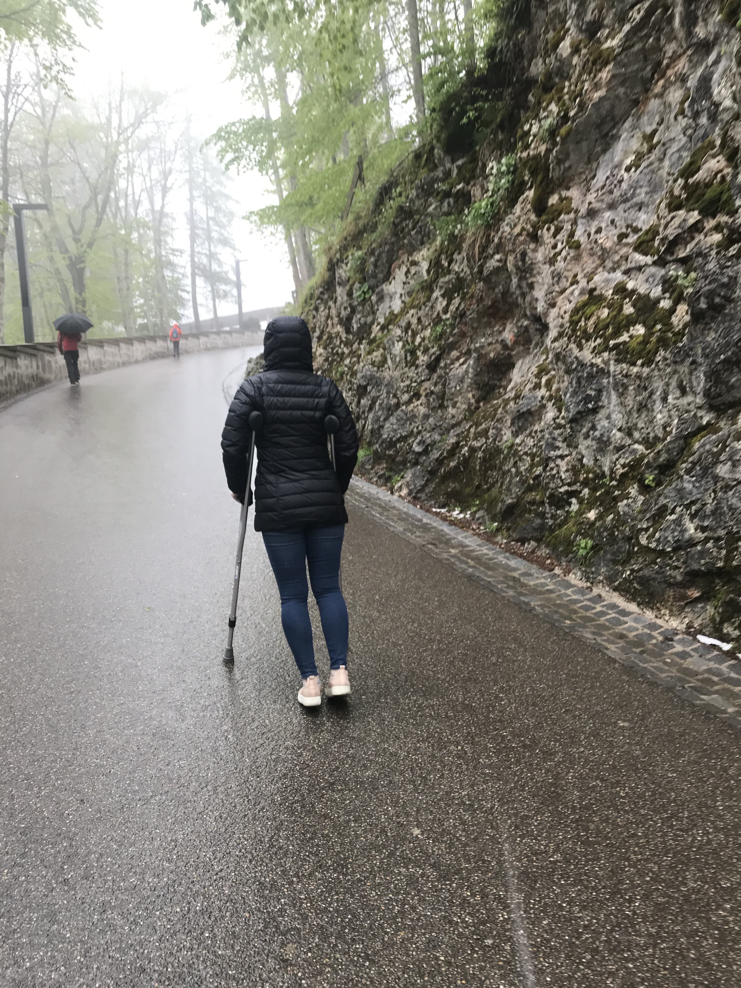 Monique McDown walking on crutches on a trip to Germany. McDown's right leg is paralyzed from an accident she was in while serving her mission in Brazil.