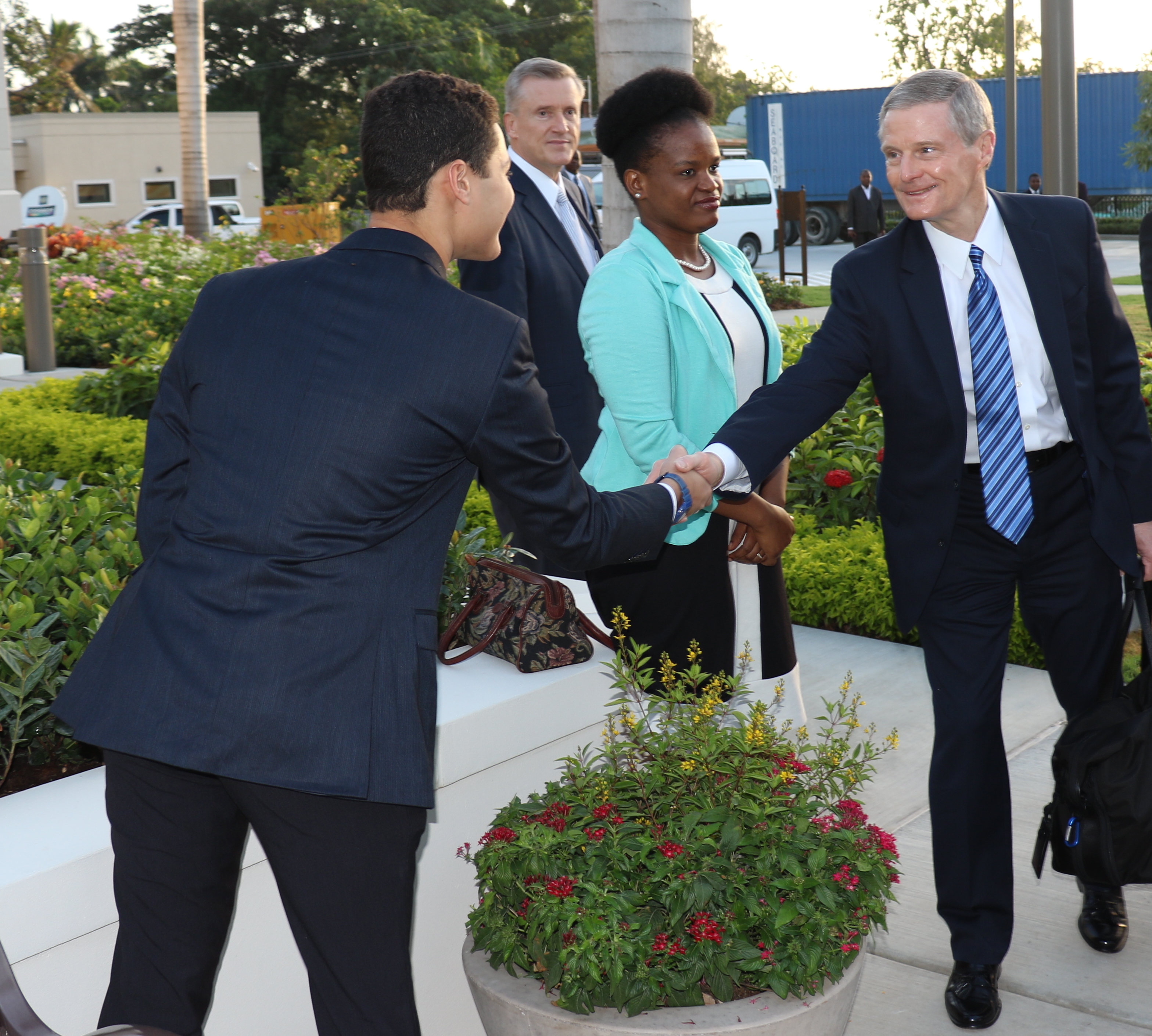 Elder David A. Bednar greets volunteers at the Sept. 1, 2019, dedication of the Port-au-Prince Haiti Temple