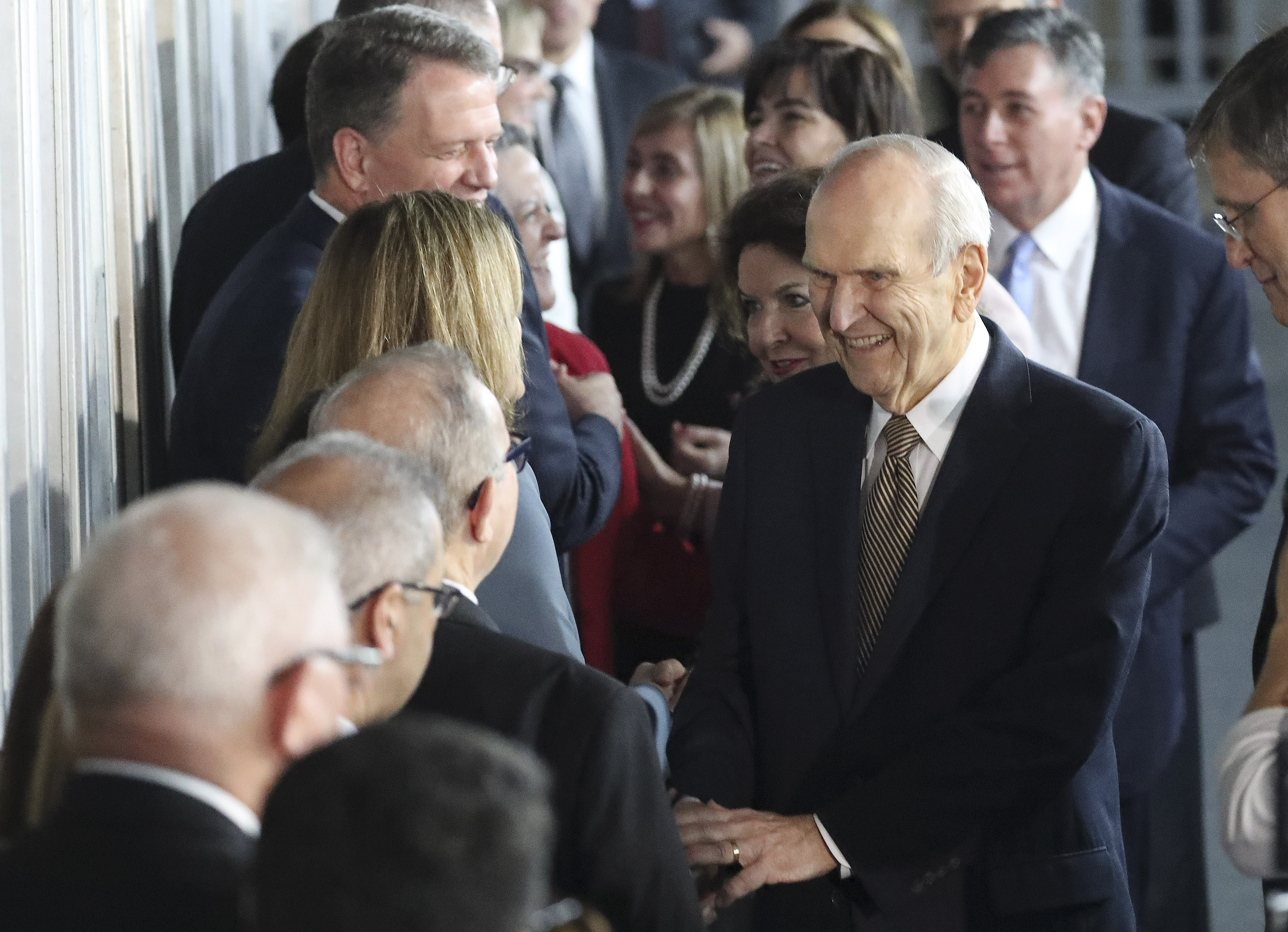 President Russell M. Nelson of The Church of Jesus Christ of Latter-day Saints and his wife, Sister Wendy Nelson, greet attendees prior to a devotional in Sao Paulo, Brazil, on Sunday, Sept. 1, 2019.
