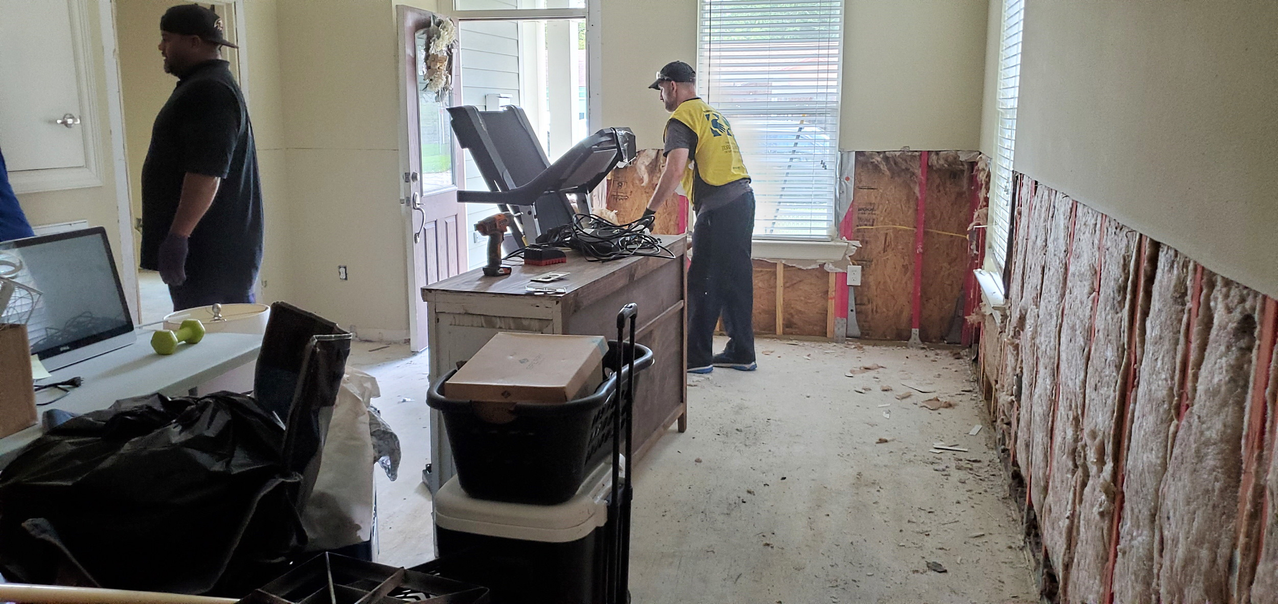 Interior walls are removed, a necessary part of the process to muck and gut homes after flood damage.
