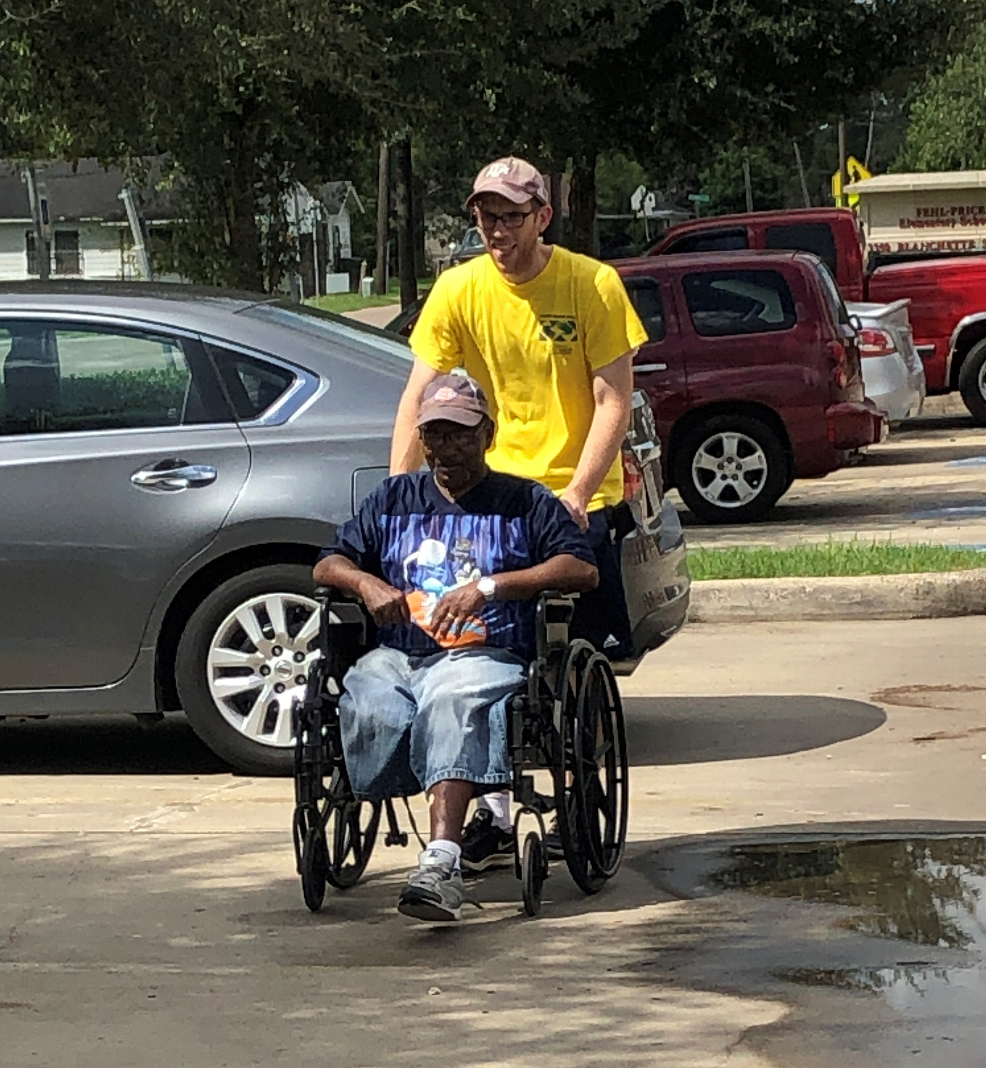 Church member Matt Albrecht helps a disabled homeowner register for a Helping Hands crew to work on his home.