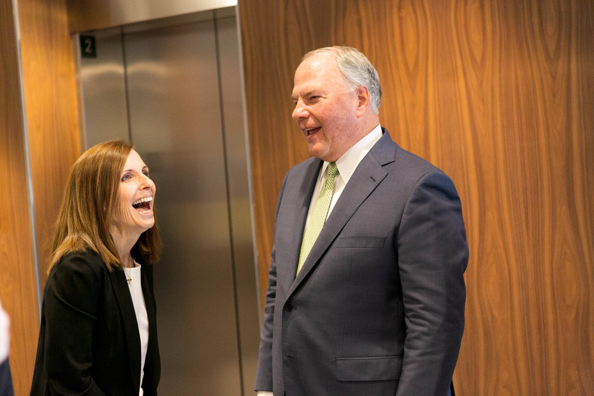 Elder Ronald A. Rasband of the Quorum of the Twelve Apostles has a light moment with Arizona's newest senator, Martha McSally, during a visit to her office on Friday, October 18, 2019.