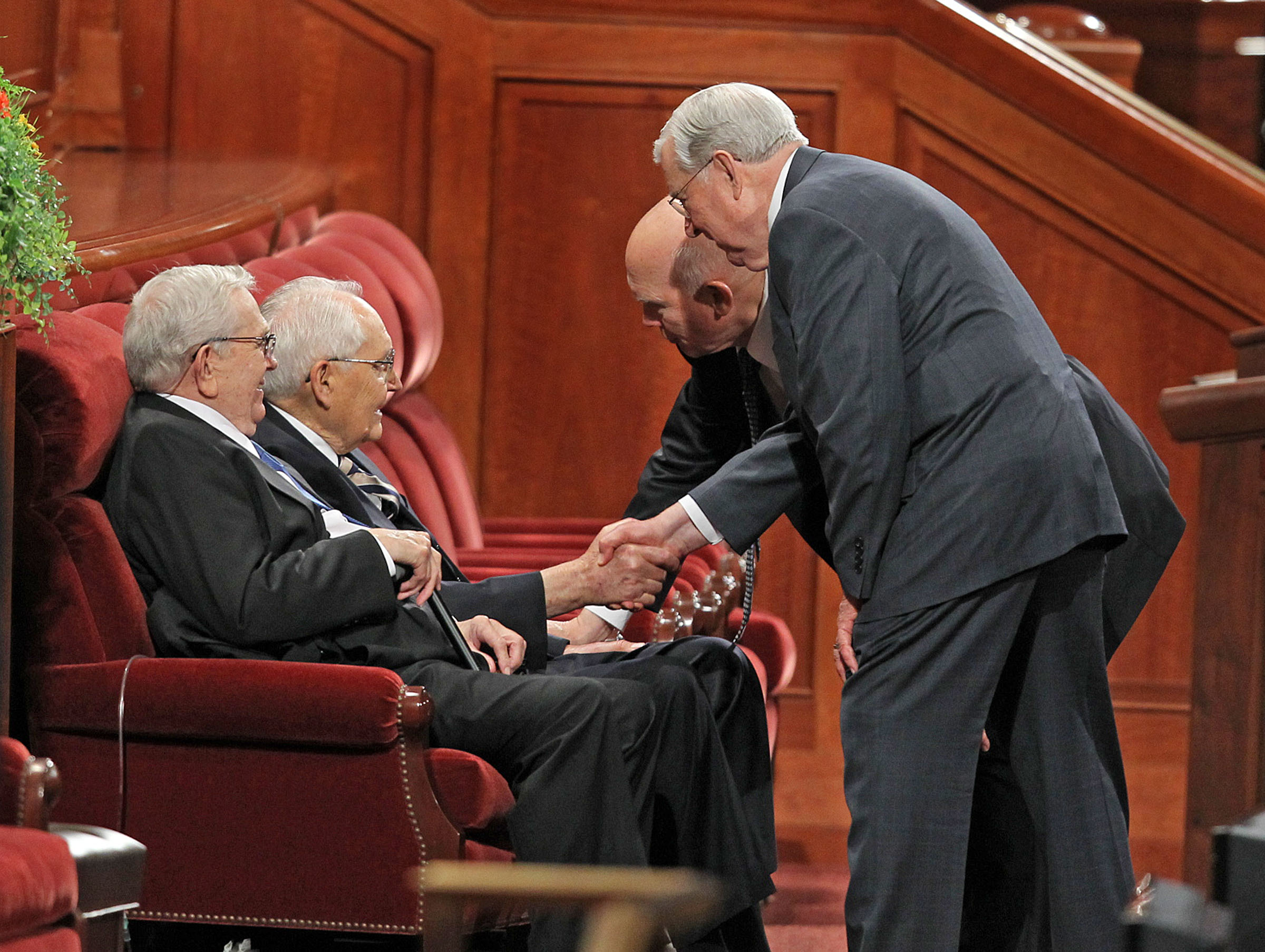 President Boyd K. Packer and Elder L. Tom Perry are greeted by Elder Dallin H. Oaks and Elder M. Russell Ballard, from left, as they visit prior to the Sunday morning session of The Church of Jesus Christ of Latter-day Saints 181st Annual General Conference Sunday, April 3, 2011, in Salt Lake City, Utah. (Tom Smart, Deseret News)