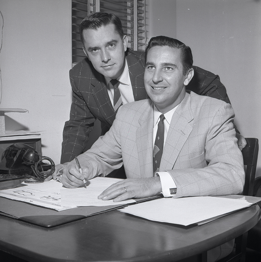 M. Russell Ballard, left, worked as the president of Ballard Motor Company, his father's car dealership, in the 1950s.